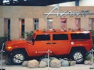 0307or 03 z+2004 studebaker xuv off road insider+orange exterior side view