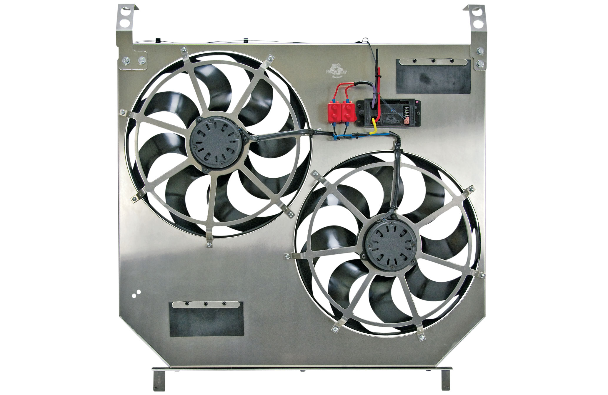 The system also includes a Flex-A-Lite exclusive clutch fan emulator that plugs into the existing control system, sending feedback to the truck ECM and avoiding potential check engine codes. The electric fans are operated by a Flex-A-Lite Variable Speed Controller that starts the fans at 60 percent power and increases fan speed as the temperature rises and lets you adjust the temperature at which the fans turn on (between approximately 160 and 240 degrees Fahrenheit). The controller also includes terminals to activate the fans when the vehicle air conditioning is turned on, as well as cockpit manual override control for tow mode or water crossings.