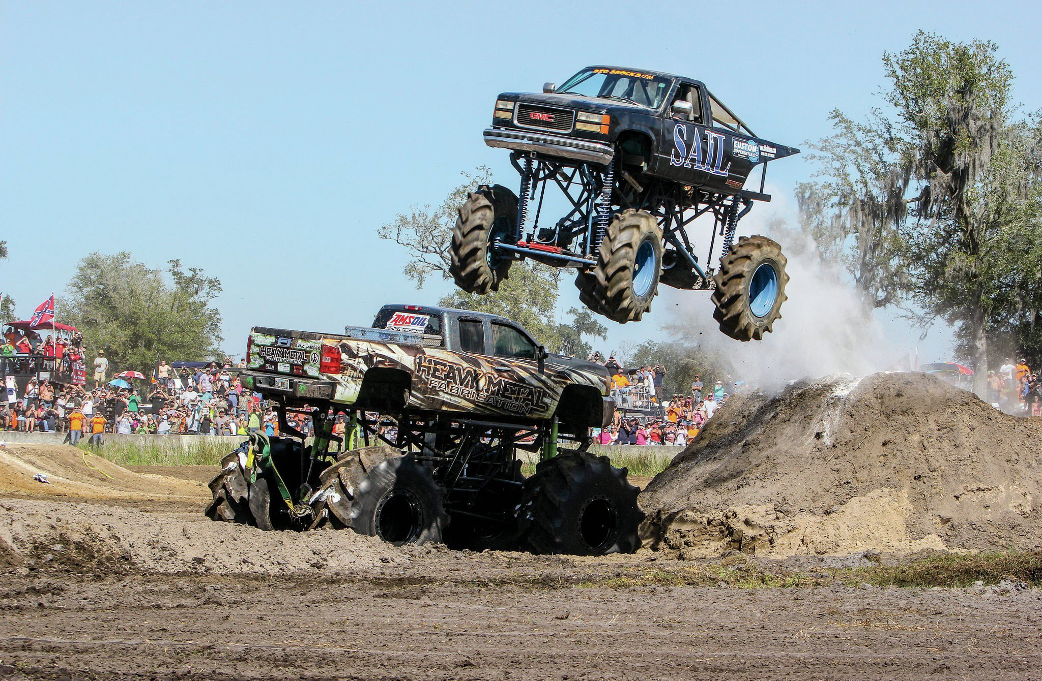 Not all events are muddy. For the crowd's entertainment, Scott Green launched his Sail mega truck over Bobby Brown's Heavy Metal mega truck during the freestyle competition. Scott was a crew member for Jeremy Naeger at Top Truck Champions' Challenge in 2012.