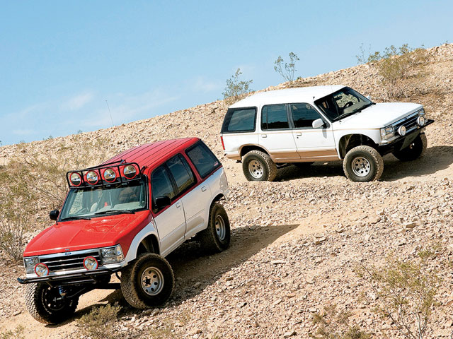 0808or 1993 25 z+ford explorer 1992 ford explorer ns off road+two ford explorers parked