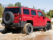 129 0809 11 z+hummer h3 upgraded shocks tires wheels project trail hugger+h3 hummer exterior rear view