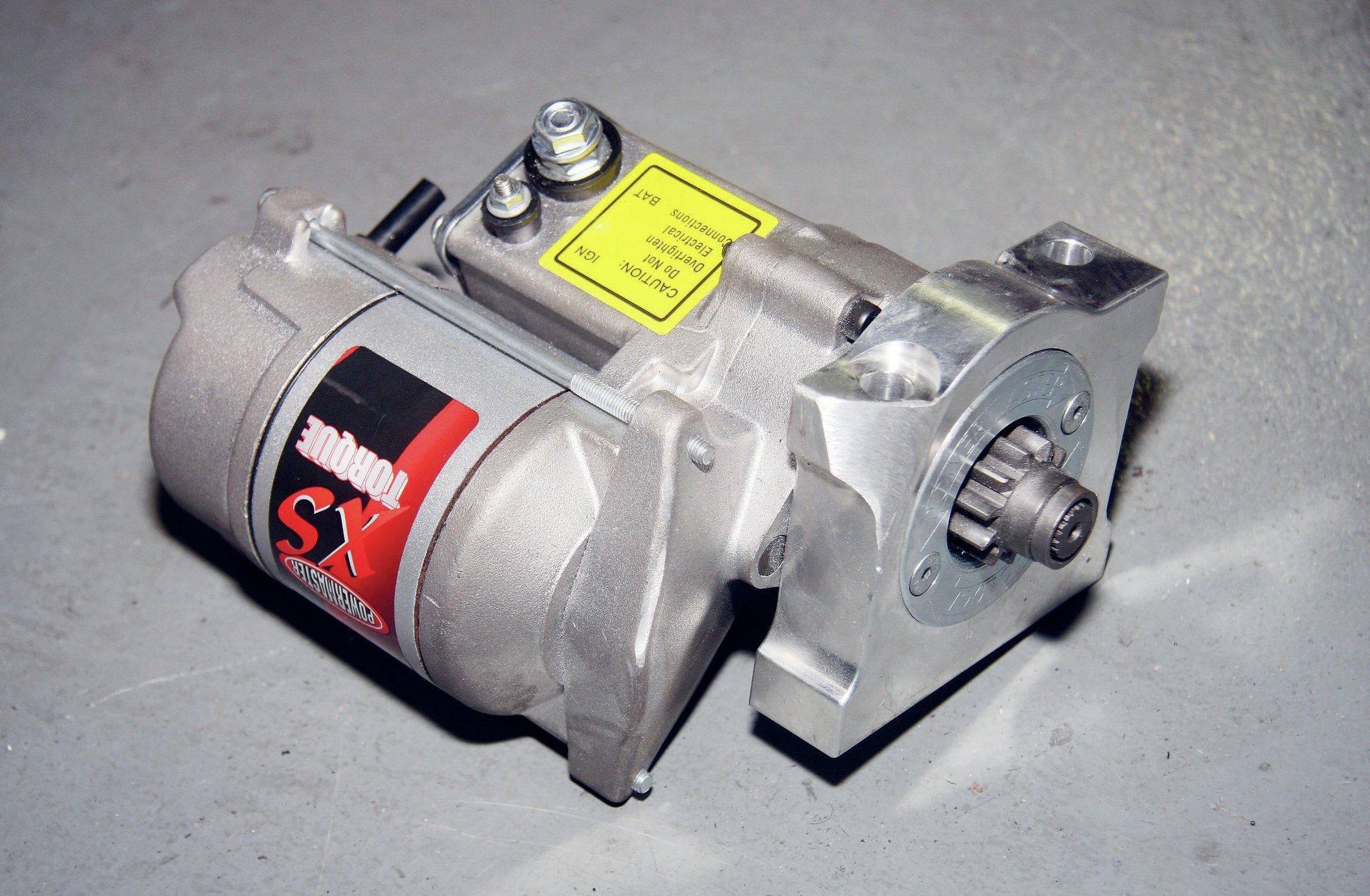 A compact Powermaster XS Torque starter was used for the swap. A corner of the starter flange had to be ground down some to clear the bellhousing. Wiring is straight-forward and the factory Jeep connections were all used on the new starter.