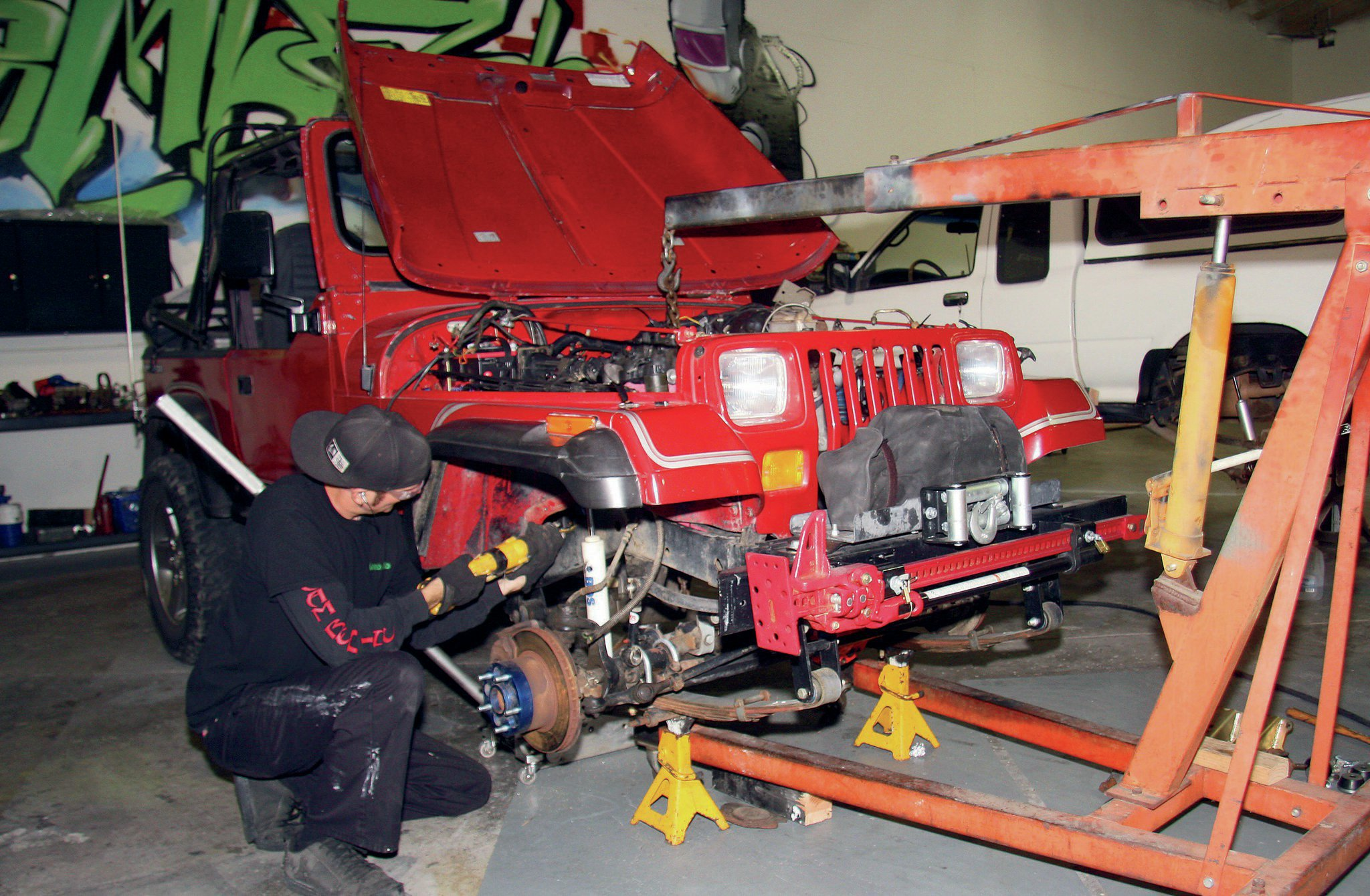 With the V-8 mocked into place, mounting position could be determined and preparation made to install new engine mounts. Time spent here is valuable to the final results. Engine placement can affect hood, radiator, and firewall clearance. Position may also affect drivetrain angle and ultimately driveshaft angles and clearances.