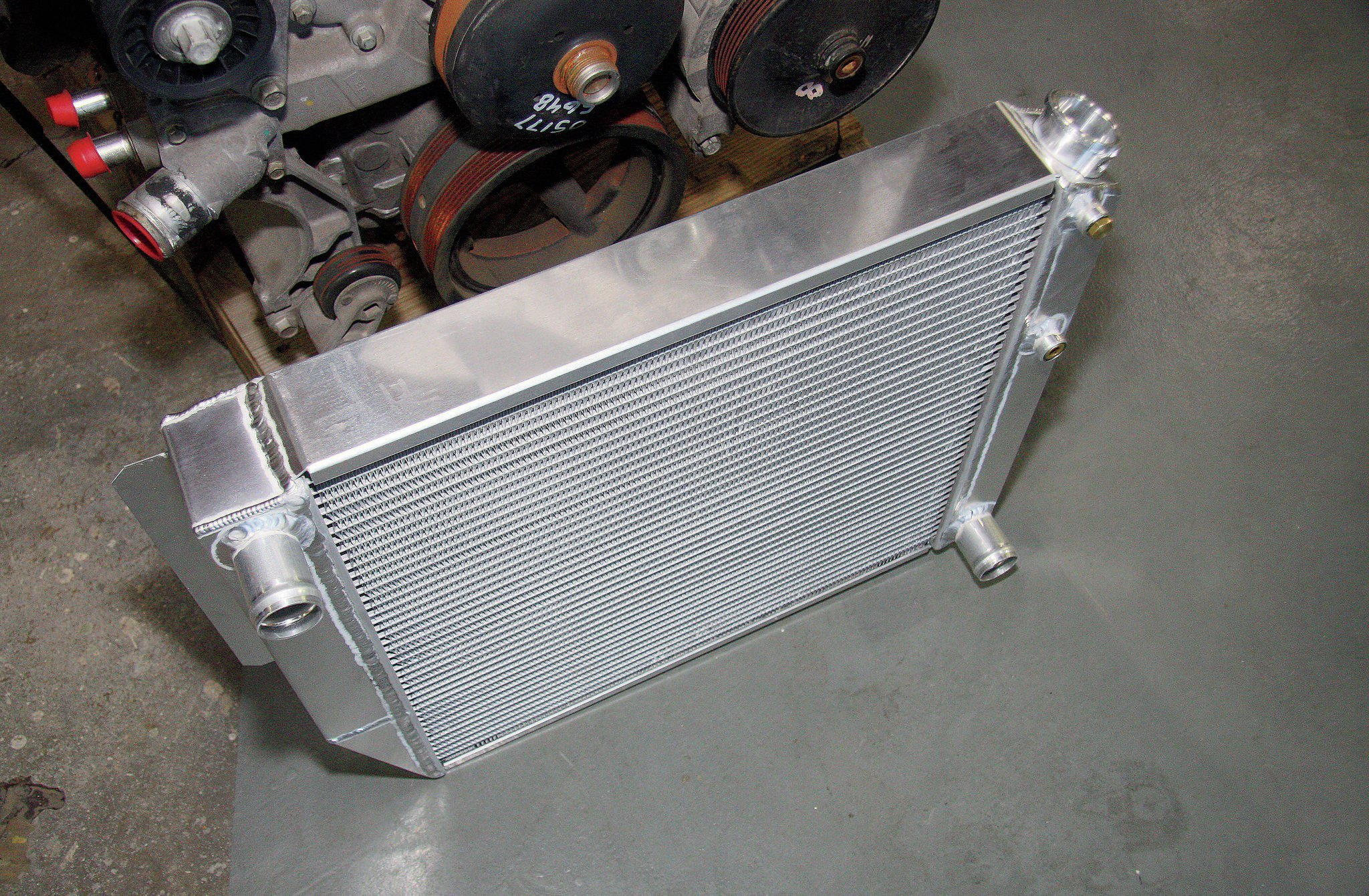 An Advance Adapters aluminum radiator was used that was designed specifically for this conversion, making it an easy bolt-in affair. The stock radiator is not up to the task of cooling the larger V-8 engine, plus all the outlets on this radiator have been placed to work with the GM LS engines.
