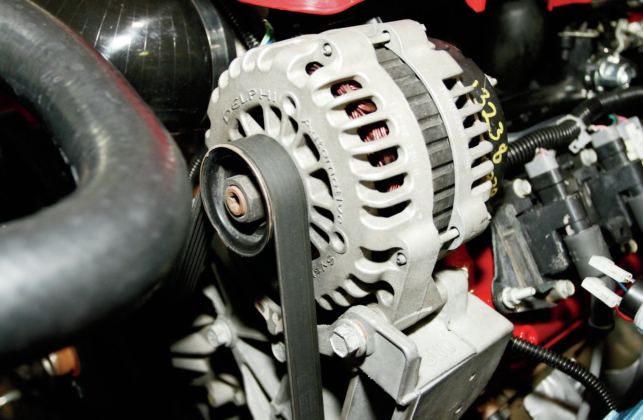 The factory GM alternator on the V-8 was retained and needed to be wired into the Jeep electrical system. The exciter wire for the alternator was built into the new harness. The main charge wire from the alternator was routed to the battery positive post, with a Maxi-Fuse used inline.