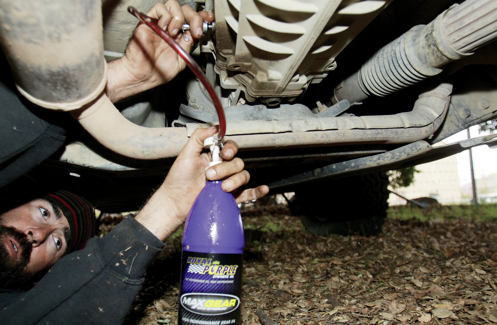 "After cleaning the drain plug magnet off again, a thin covering of light shavings is perfectly normal—reinstall it and wipe everything down. You can then start refilling your transmission with the Mopar MS-9224 transmission fluid or equivalent. An approved equivalent fluid will say ""Meets MS-9224,"" usually found on the back of the bottle. You will need a 14mm hex key for the fill plug, located midway up on the passenger side of the transmission."