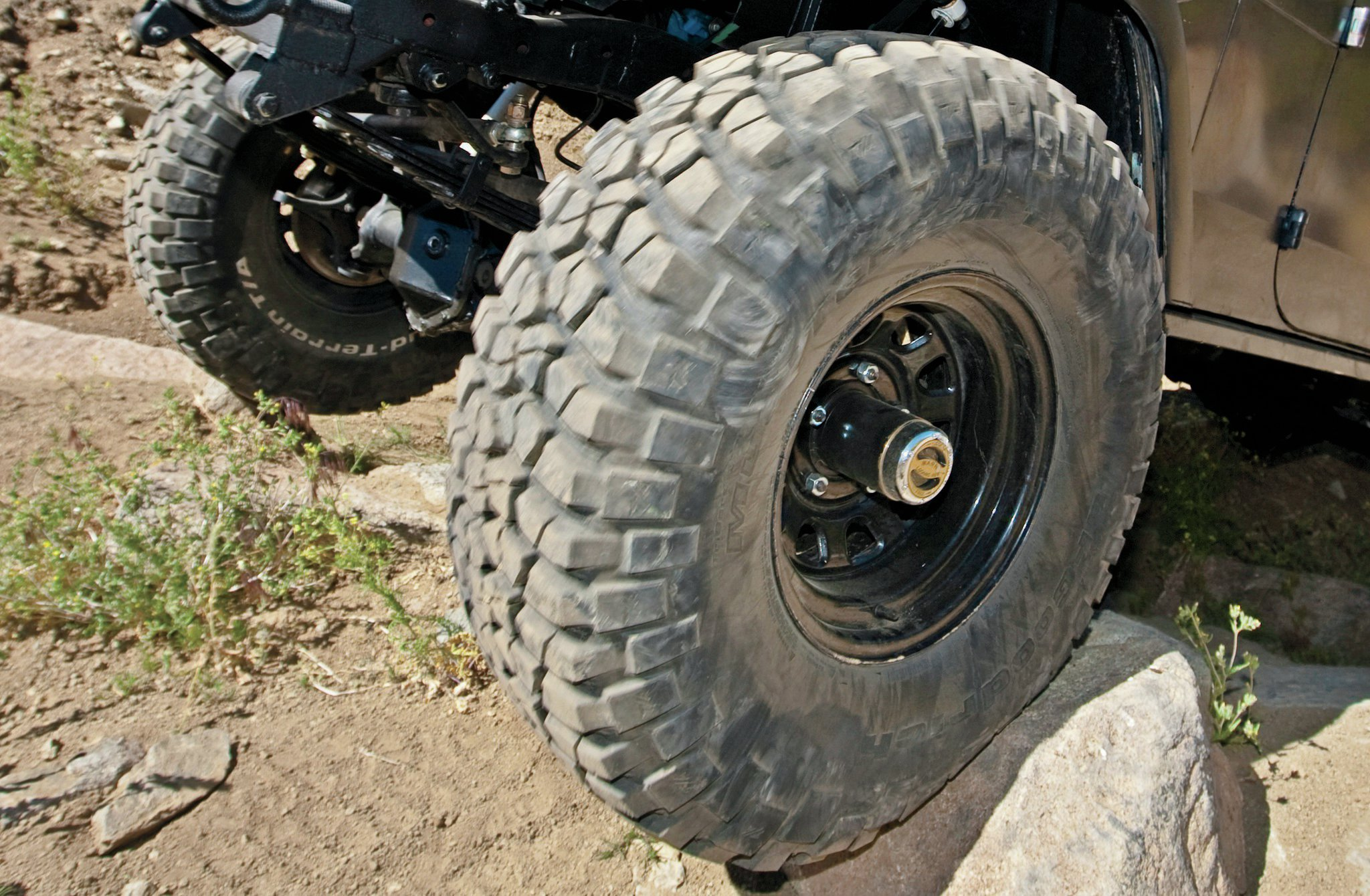 Steel wheels bend rather than break upon impact, which typically only occurs at high speeds or low air pressure. The steel wheel can be bent back into shape with a hammer to hold air and limp off the trail, but it should be replaced once you return home.