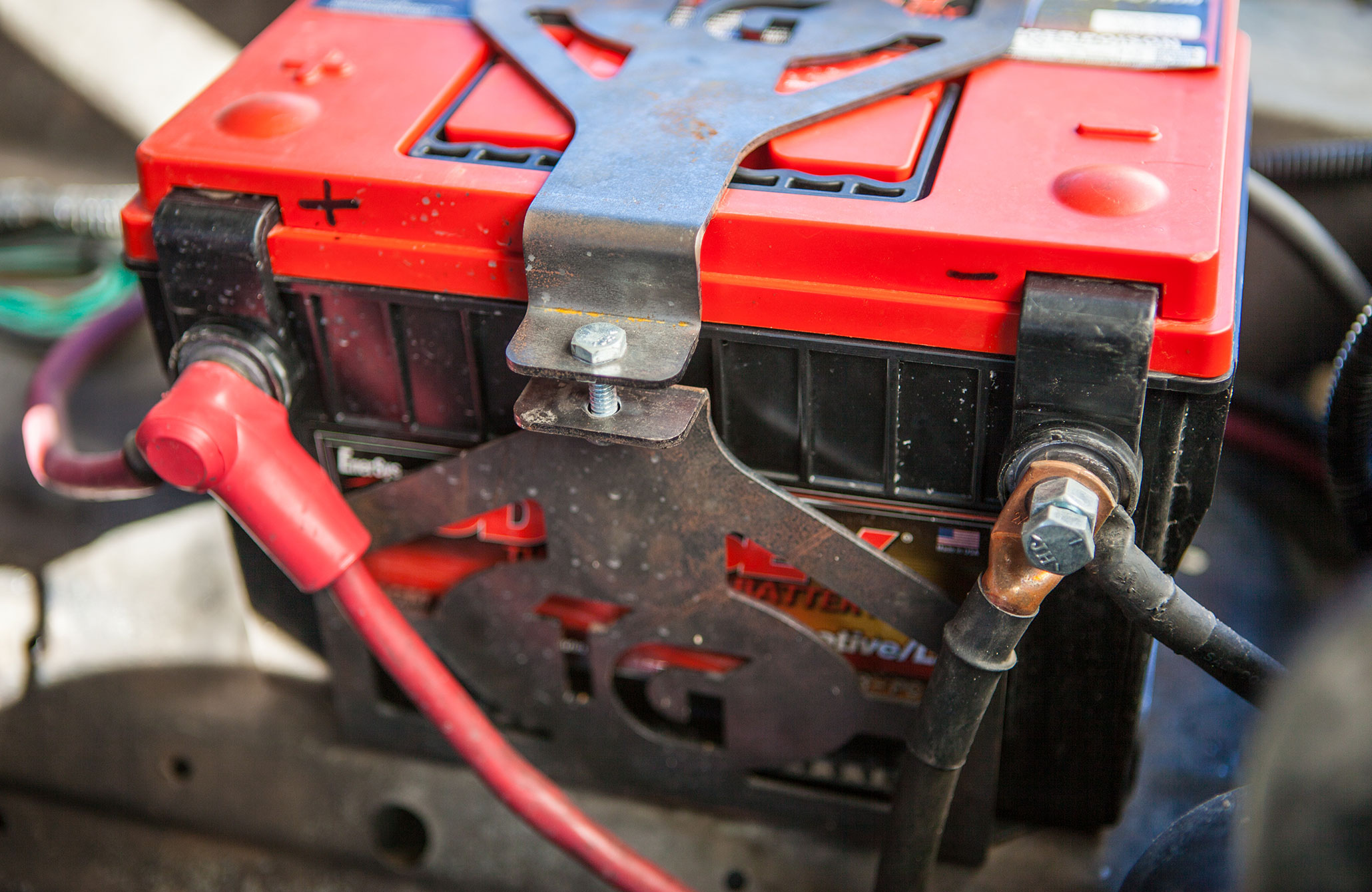 Some batteries use post terminals, while others use accept ring terminals. The terminals can be located on the side of the battery or the top of the battery. Odyssey offers post terminals that can be added to any of the company's batteries to retain compatibility with your factory cables. Here we used standard hardware to ease the addition of jumper cables and covered the positive post to ensure that we do not arc across the battery.
