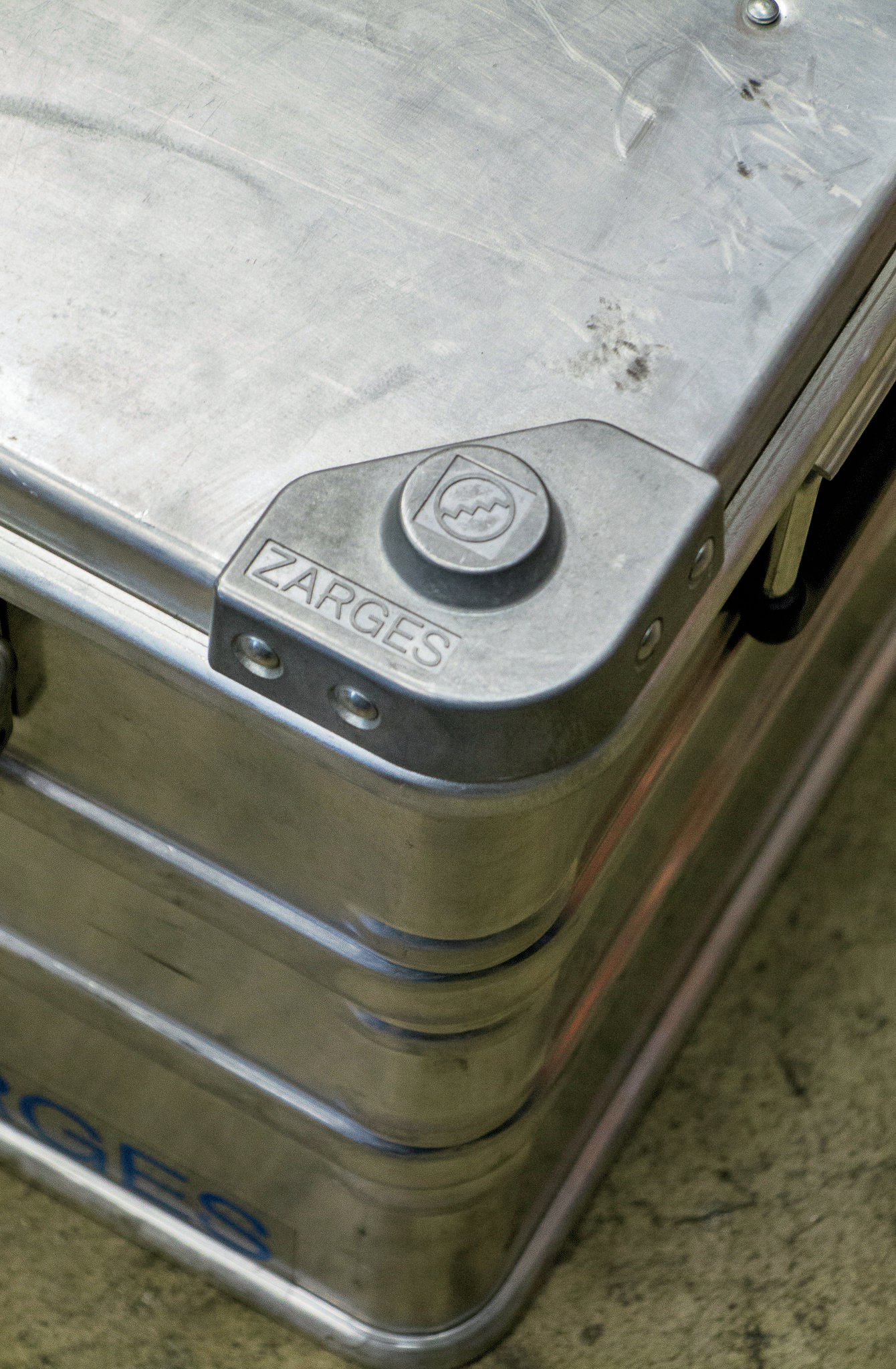The feet on Zarges cases make them easy to stack without concern about them sliding around. Tie-downs through the handles hold them securely in place and allow you to still open the lid and access the contents.
