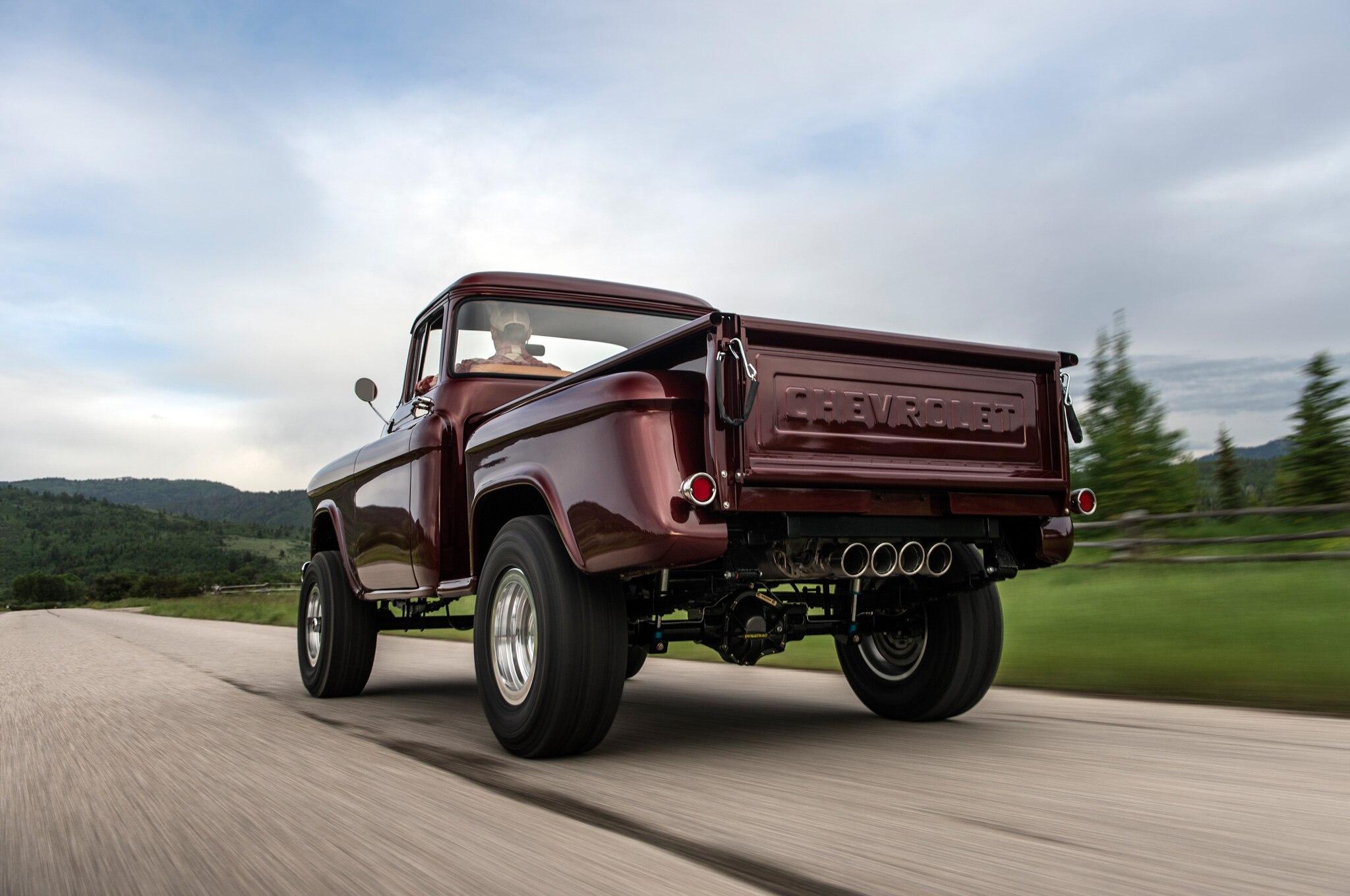 1957 chevrolet task force napco legacy classic trucks rear three quarter low in motion