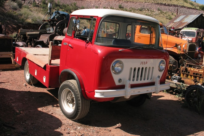 Two Guys in an Old Jeep Pickup Searching Out Rusty Arizona Auto Treasures