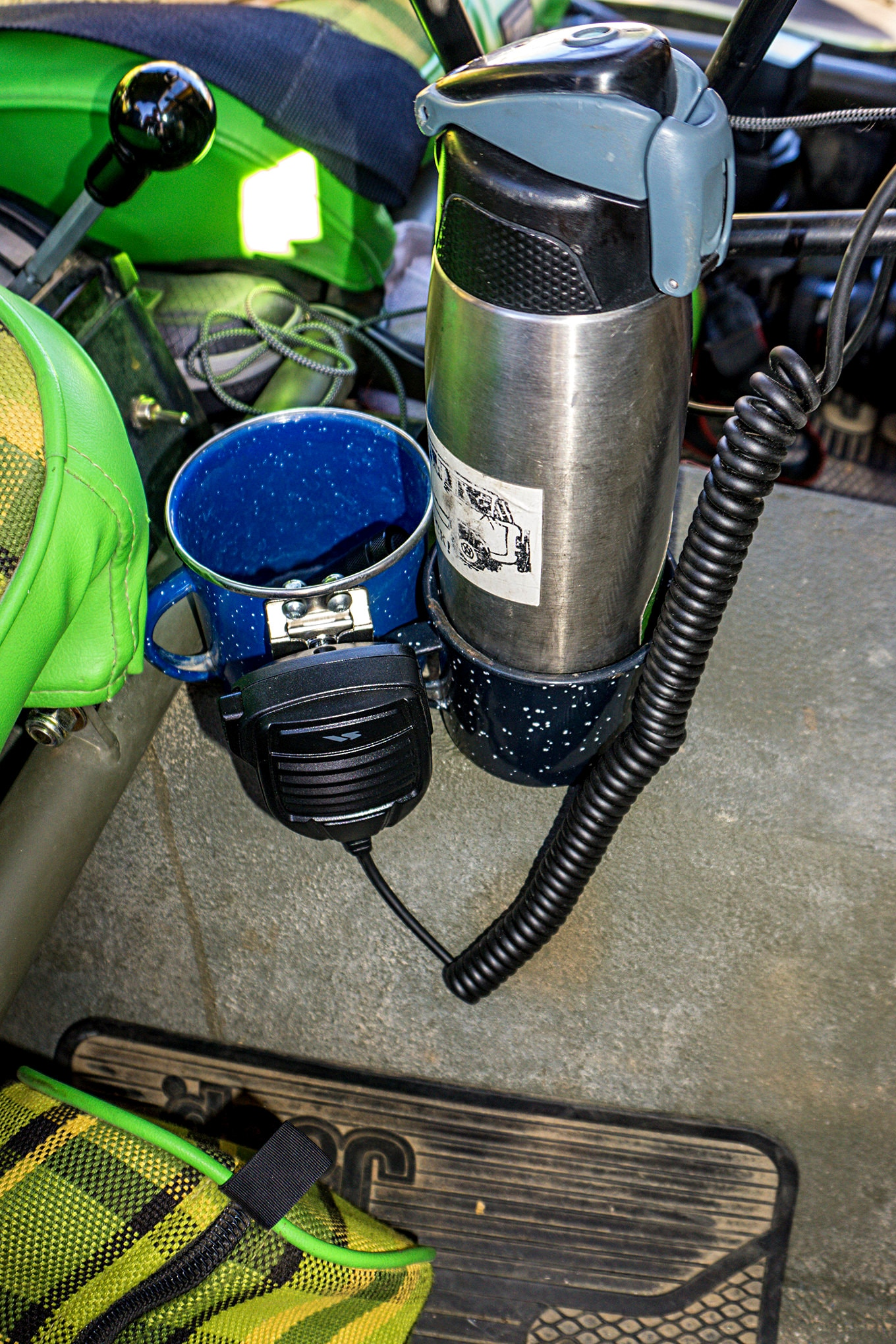Fred Williams gives credit for these cupholders to the guys at Mopar Underground, who had tip cups bolted down in their FC concept at Moab. The cups are bolted to the tranny tunnel of the Jeep and provide convenient storage, but the locate does mean that they get hot on the trail.
