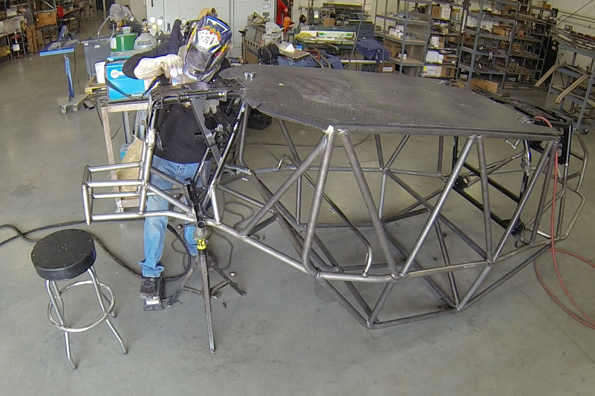 Once all the tack welds are in place and upper TIG wending has taken place, the cage is flipped over and the welding is finished.