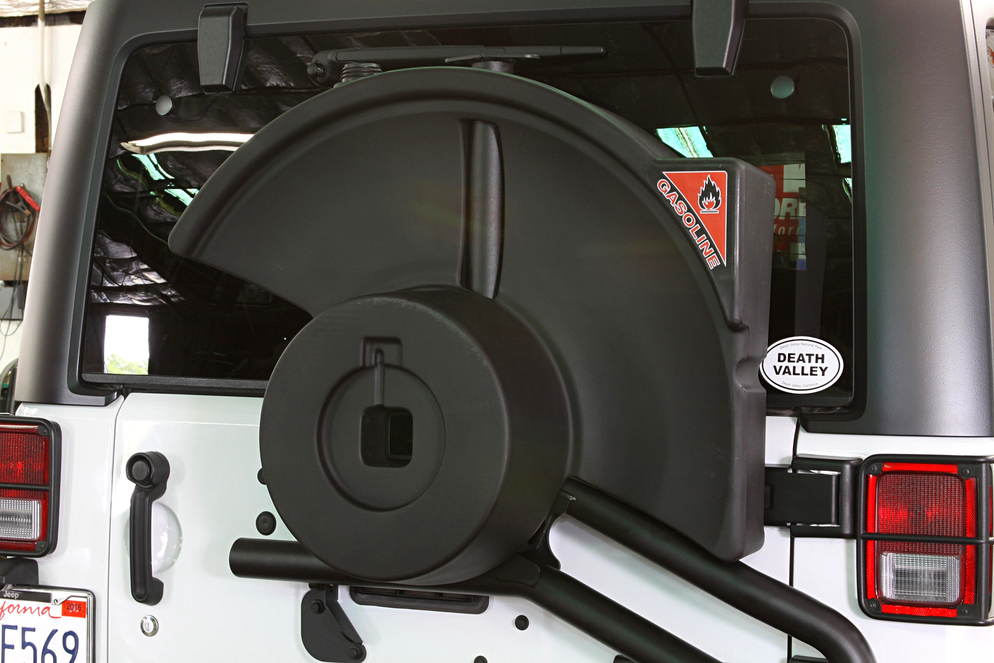 Another option we loved was the AEV 10.2-gallon fuel caddy. Made from ultra-tough cross-link polyethylene (just like what used in many factory fuel tanks), it's a great way to carry extra fuel without the bulk of external jerry cans. The fuel caddy has several attachment points to the tire carrier. The system is also designed to accommodate wiring for all the various accessories. It's also fully vented and uses an OE-style cap. The fuel tank's high-mount position means it's easy to gravity feed fuel into the main fuel tank with the included shaker siphon, and the fuel tank allows the carrier to accommodate a 40-inch.