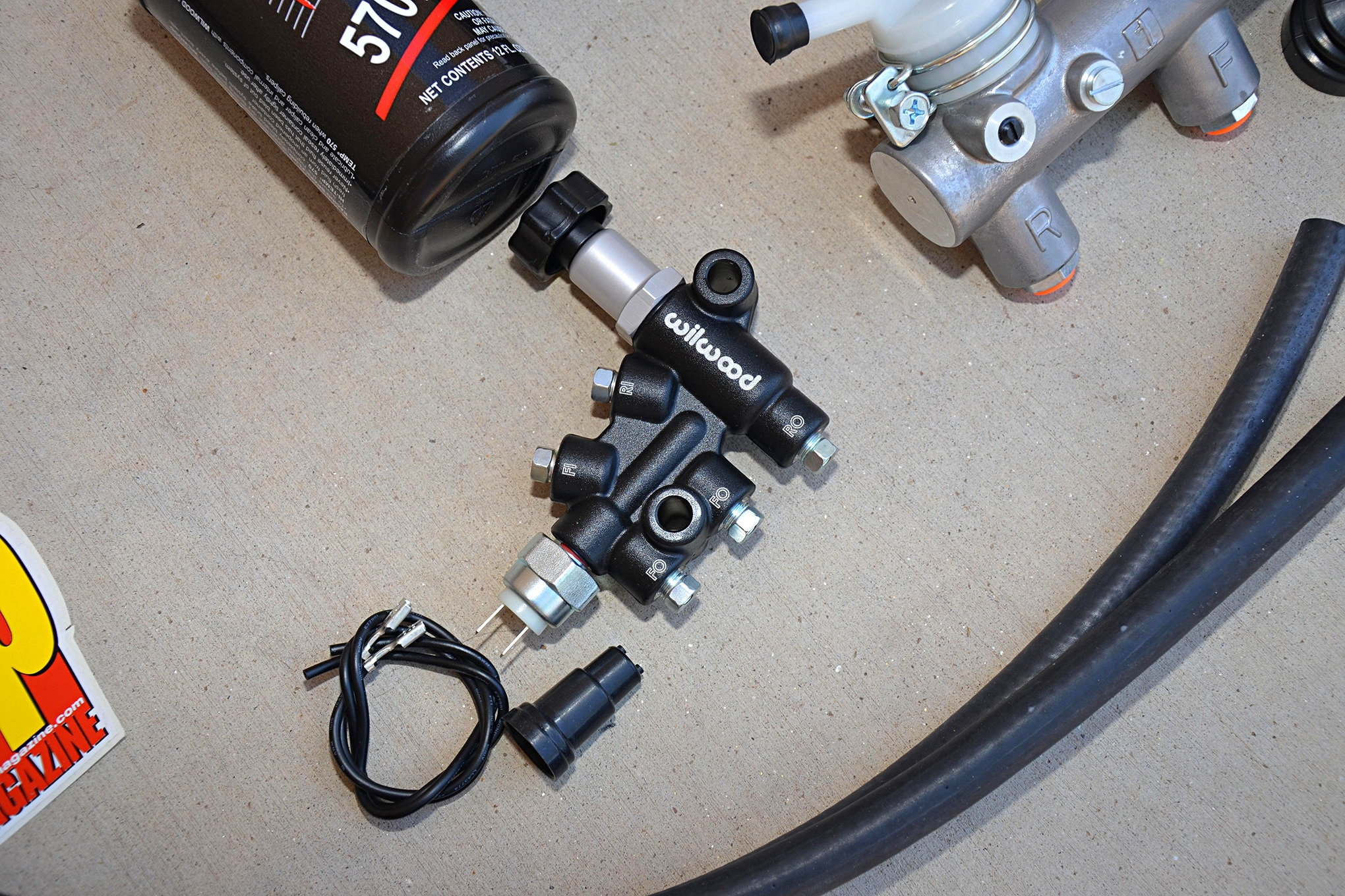 This is an adjustable proportioning valve from Wilwood Disc Brakes. By turning the knob you can reduce how much fluid travels to the rear brakes. This allows you to fine tune how much work the front and rear brake circuits are doing when you stop. Adjustable proportioning valves are also helpful when swapping axles and adding larger, or disc brakes to your rear axle.