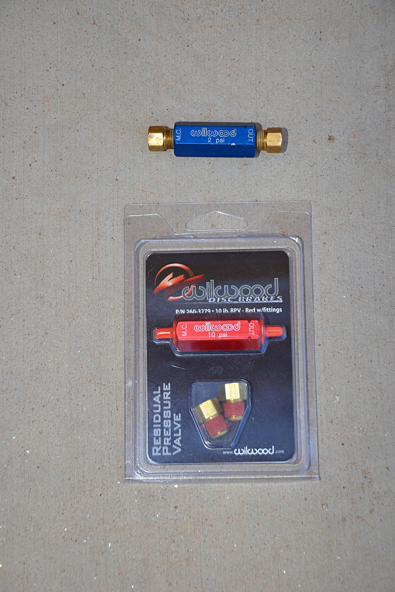 Wilwood also sells two residual pressure valves for custom braking systems. The company's 2-pound residual pressure valve (blue) is for use with disc brakes where the master cylinder is mounted low and brake fluid backflow could occur. The 10-pound residual pressure valve (red) is for drum brake systems to hold the shoes against the drums and reduce pumping.