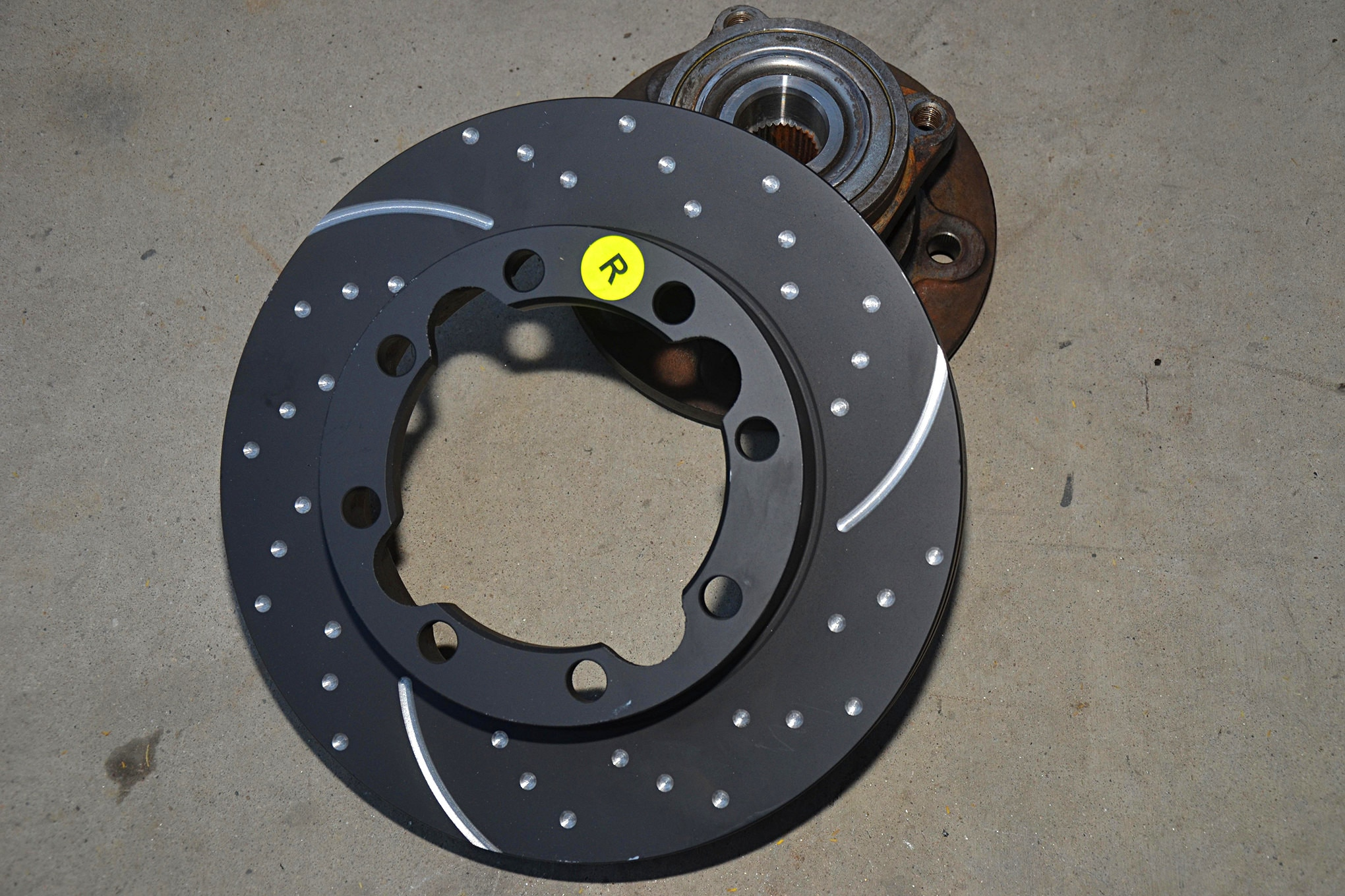 These EBC rotors are made out of high carbon and silicon steel for outstanding braking performance. Each rotor is drilled and machined to help the rotor shed heat. The directional slots machined in the rotor mean there is a right and left rotor. The black coating keeps the rotors from corroding before installation.