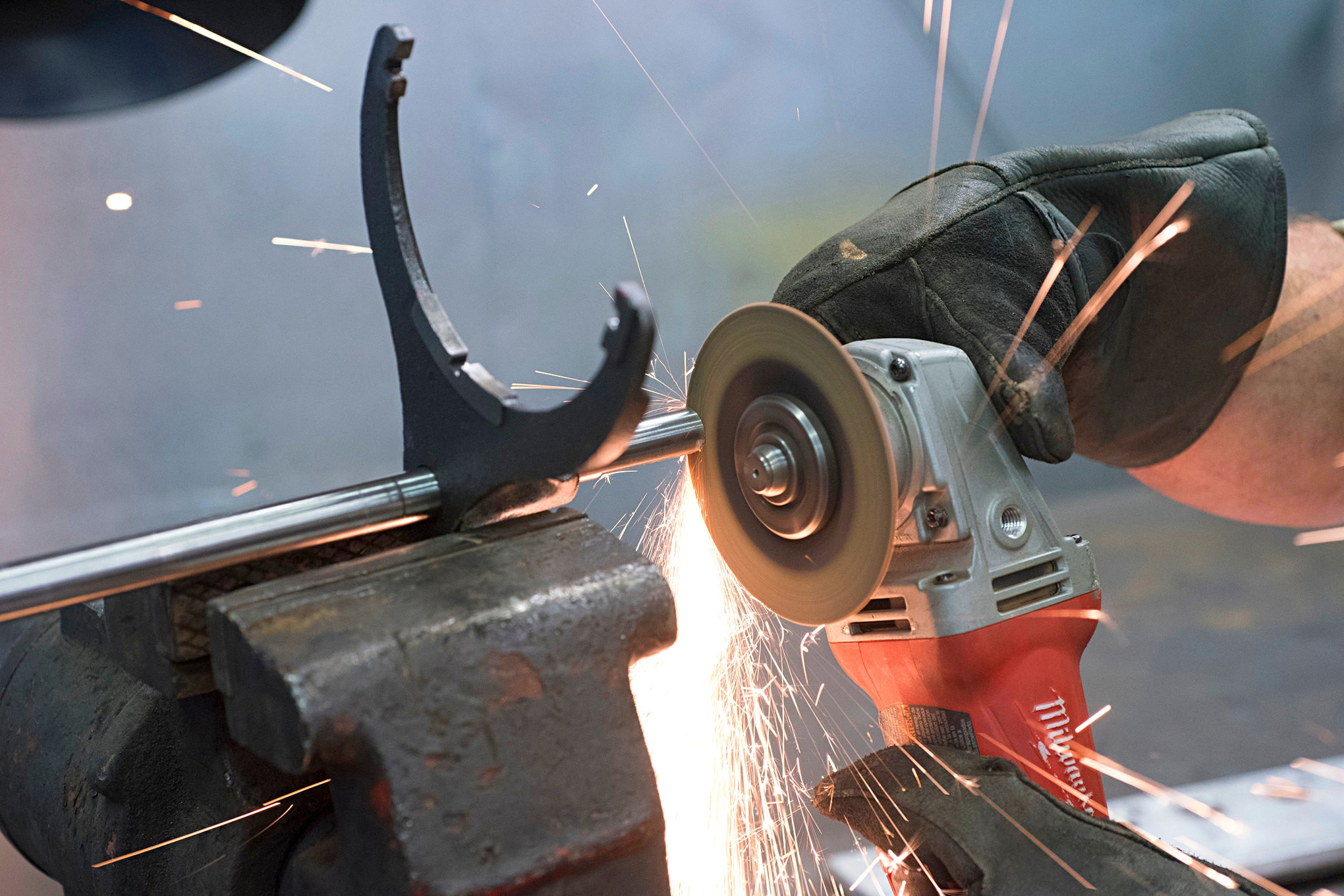 The best way to shorten the range fork shaft is to put it in a vise and use a cut-off wheel. Wearing leather gloves and safety glasses is prudent when doing such work. Smooth and bevel the cut end of the shaft when finished.