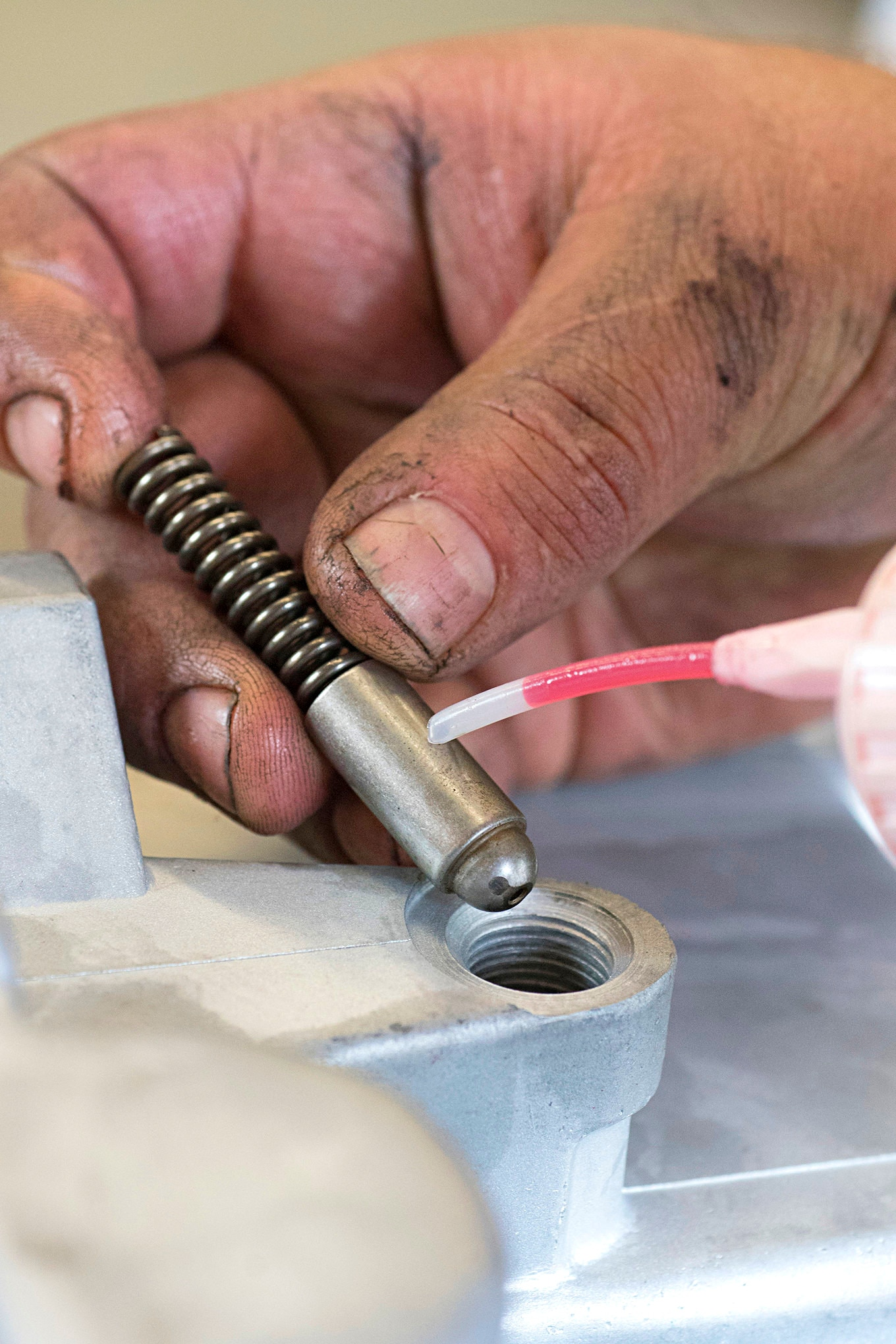 Reinstall the shift detent spring with the supplied O-ring and plug. It should be lubricated with ATF as well.