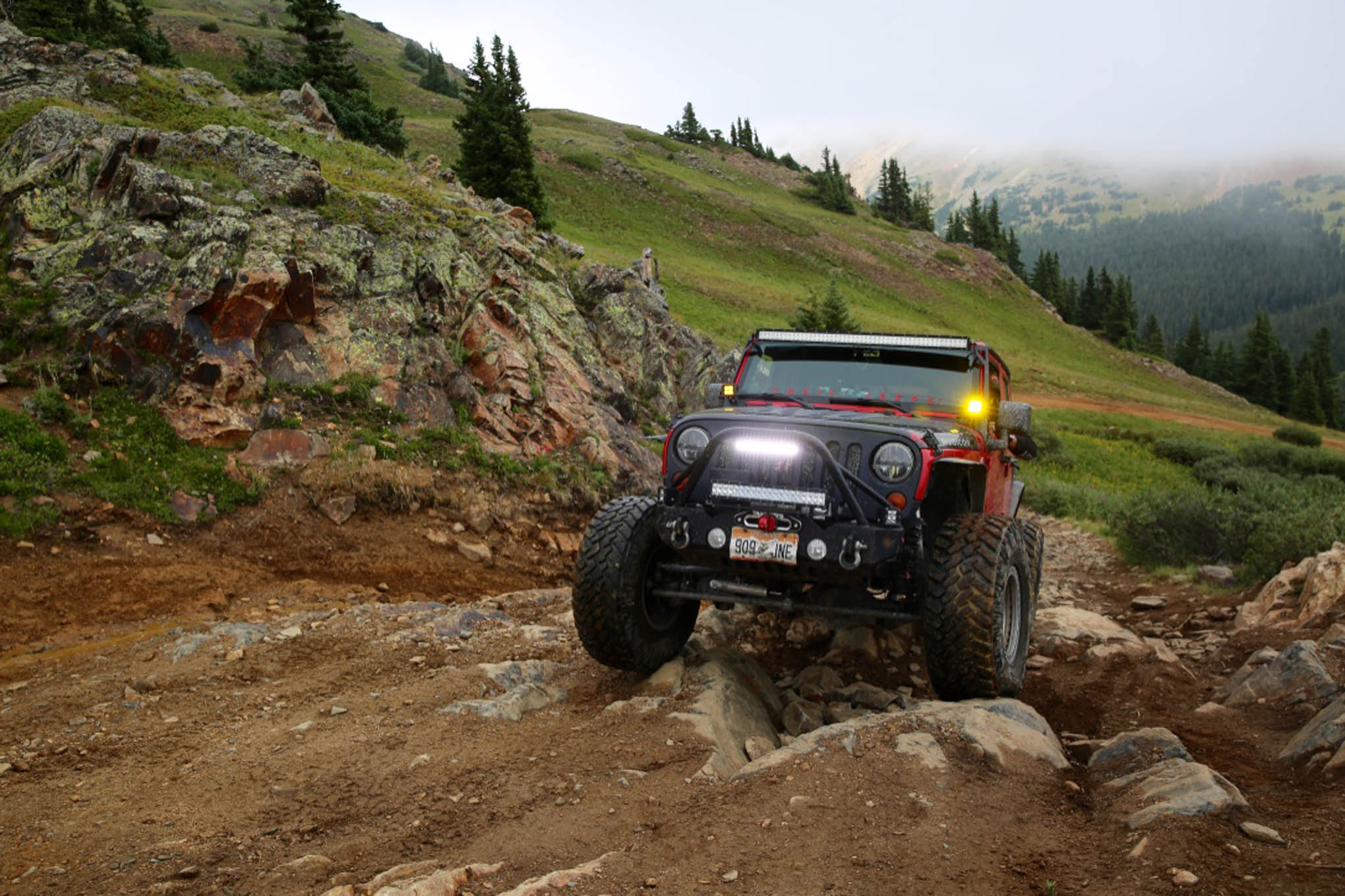 Paul Goodman crawls over a rocky section of Radical Hill in his '11 JK Unlimited Rubicon built by Trail Jeeps.