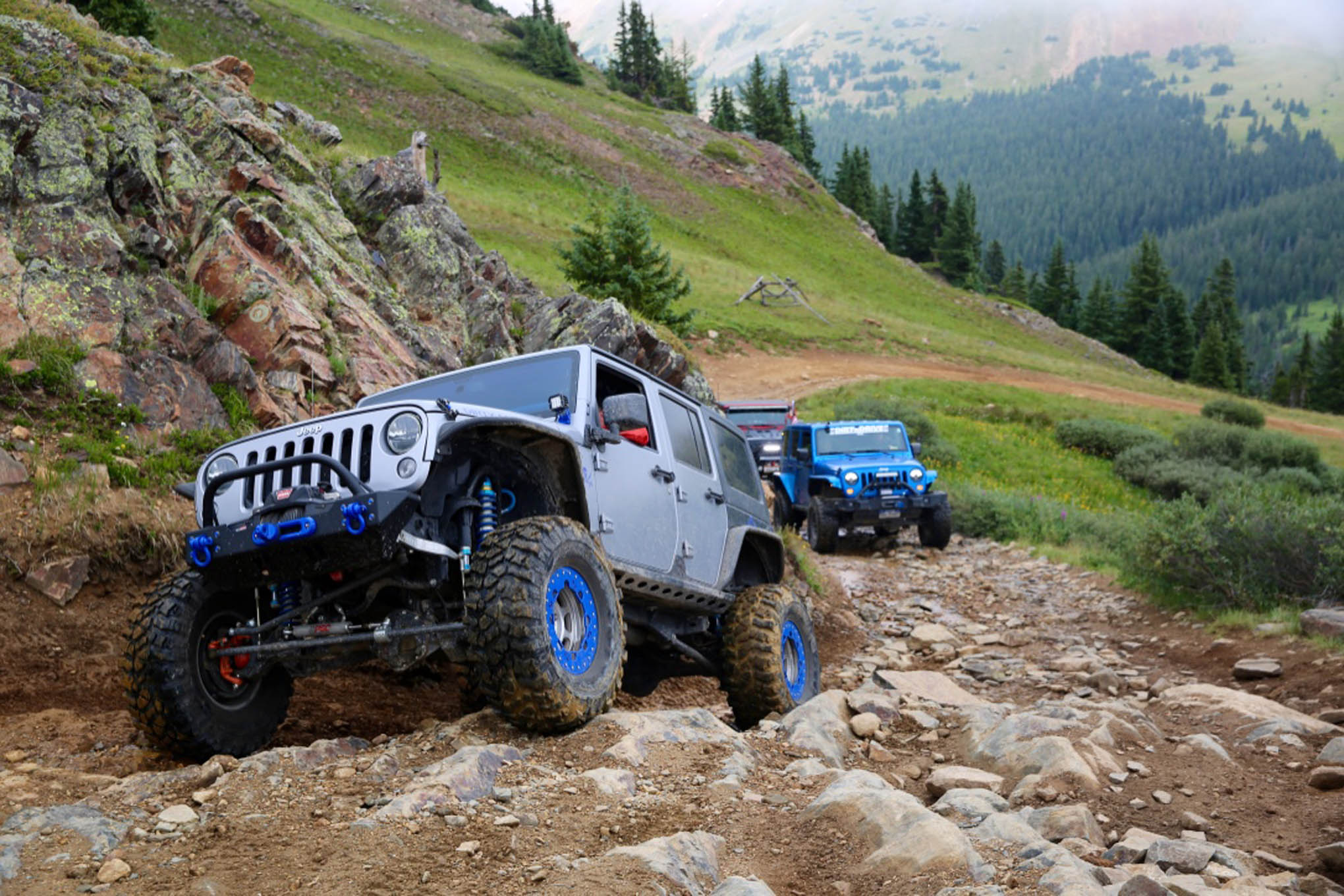 A '13 JK Unlimited carefully negotiates a gnarly section of Radical Hill.