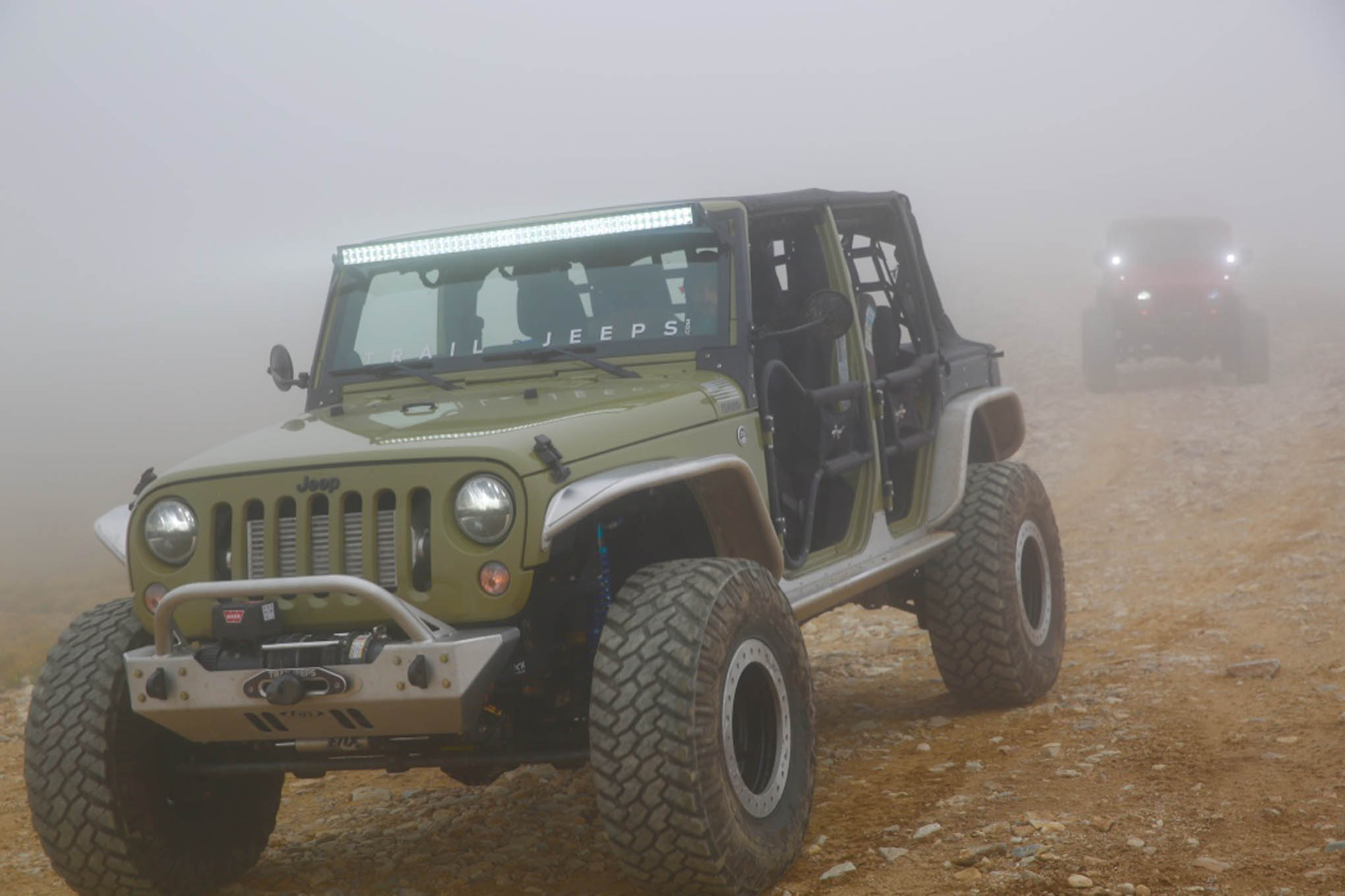 A radical new rig built by Trail Jeeps crawls down from the summit of Red Cone Peak through the dense fog.