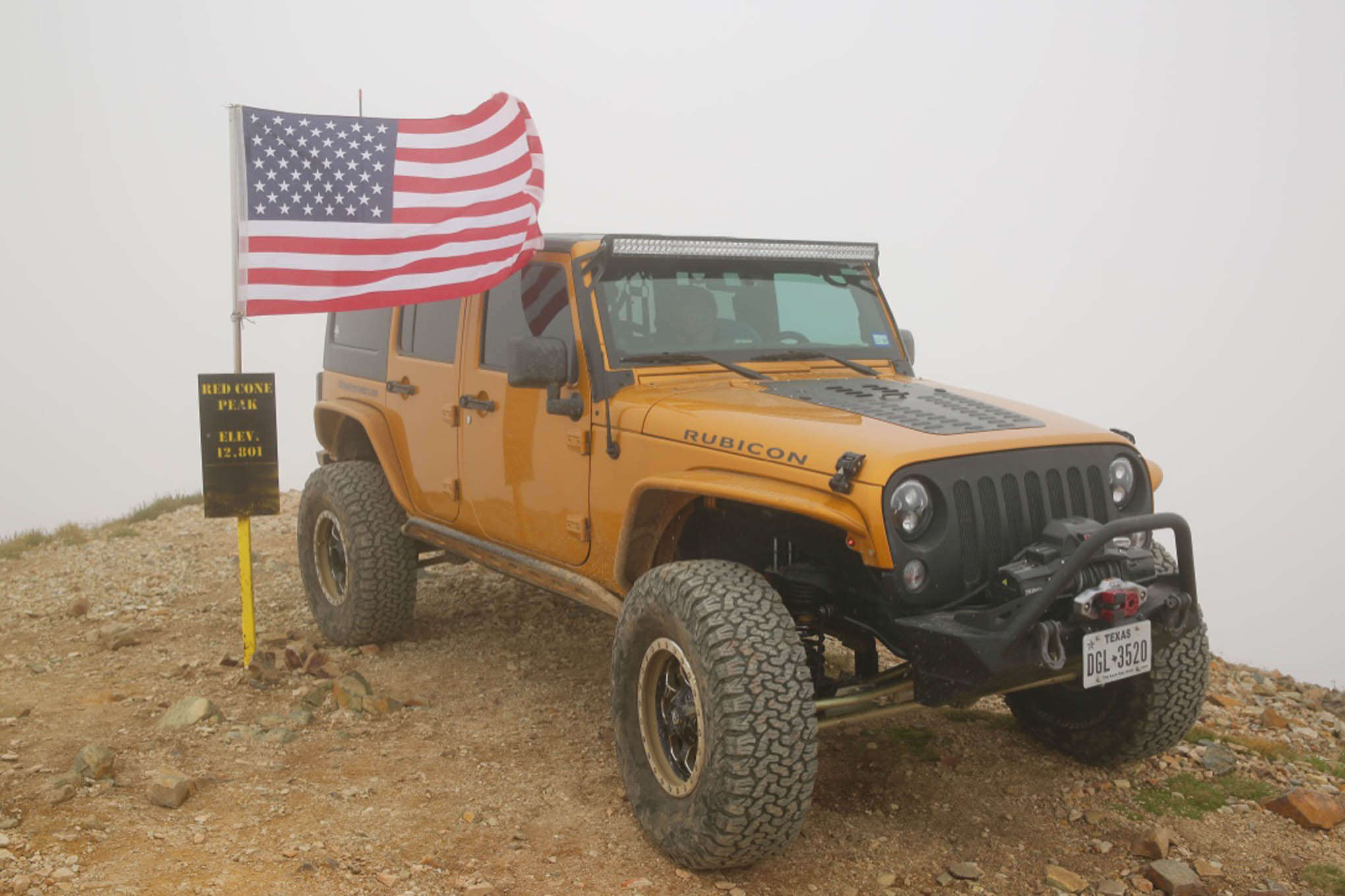 David Moose from Houston, Texas, at the summit of Red Cone Peak in his built '14 JK Unlimited Rubicon.