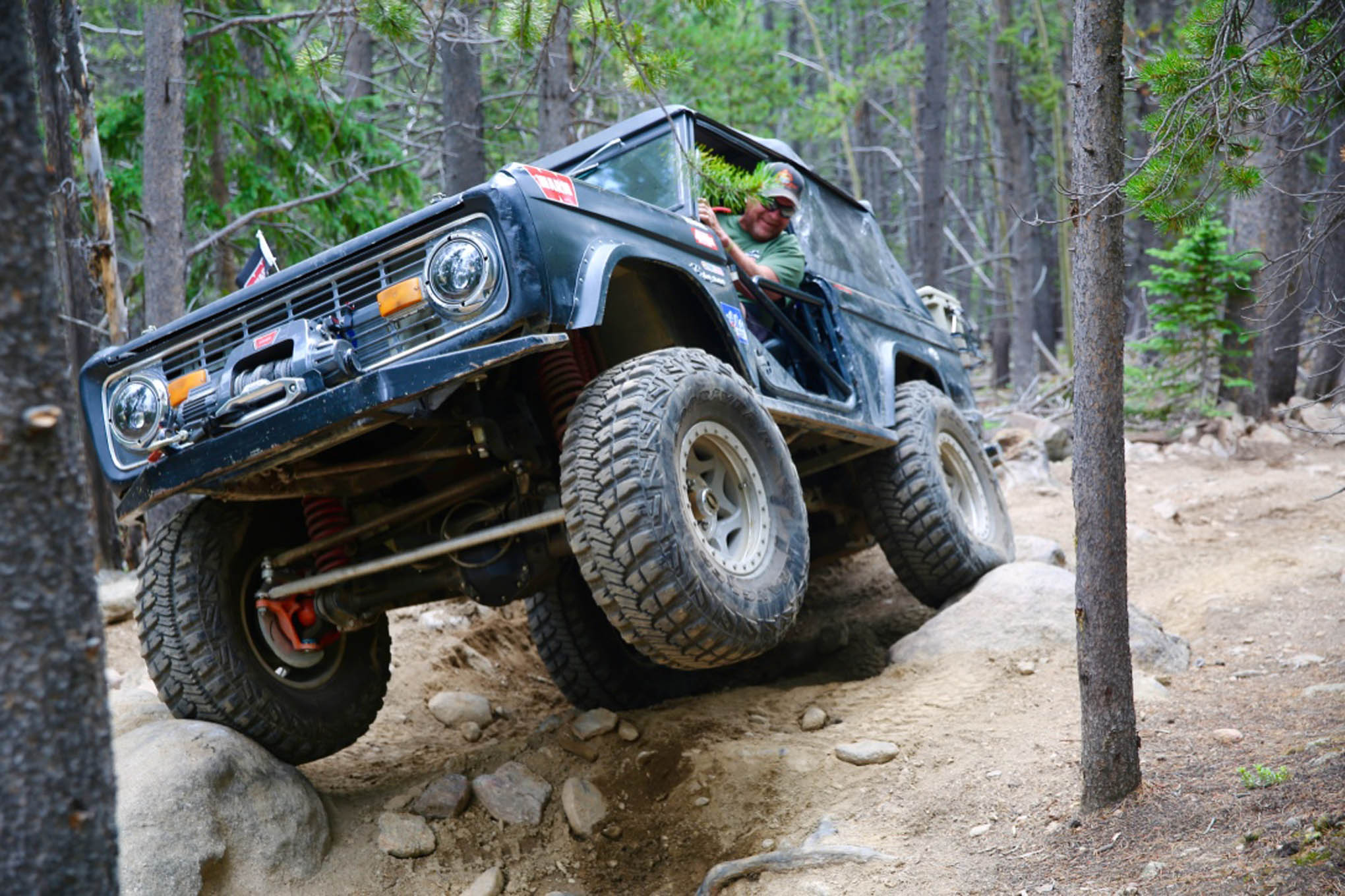 A vintage Bronco gets some air on a section of Red Elephant Trail.