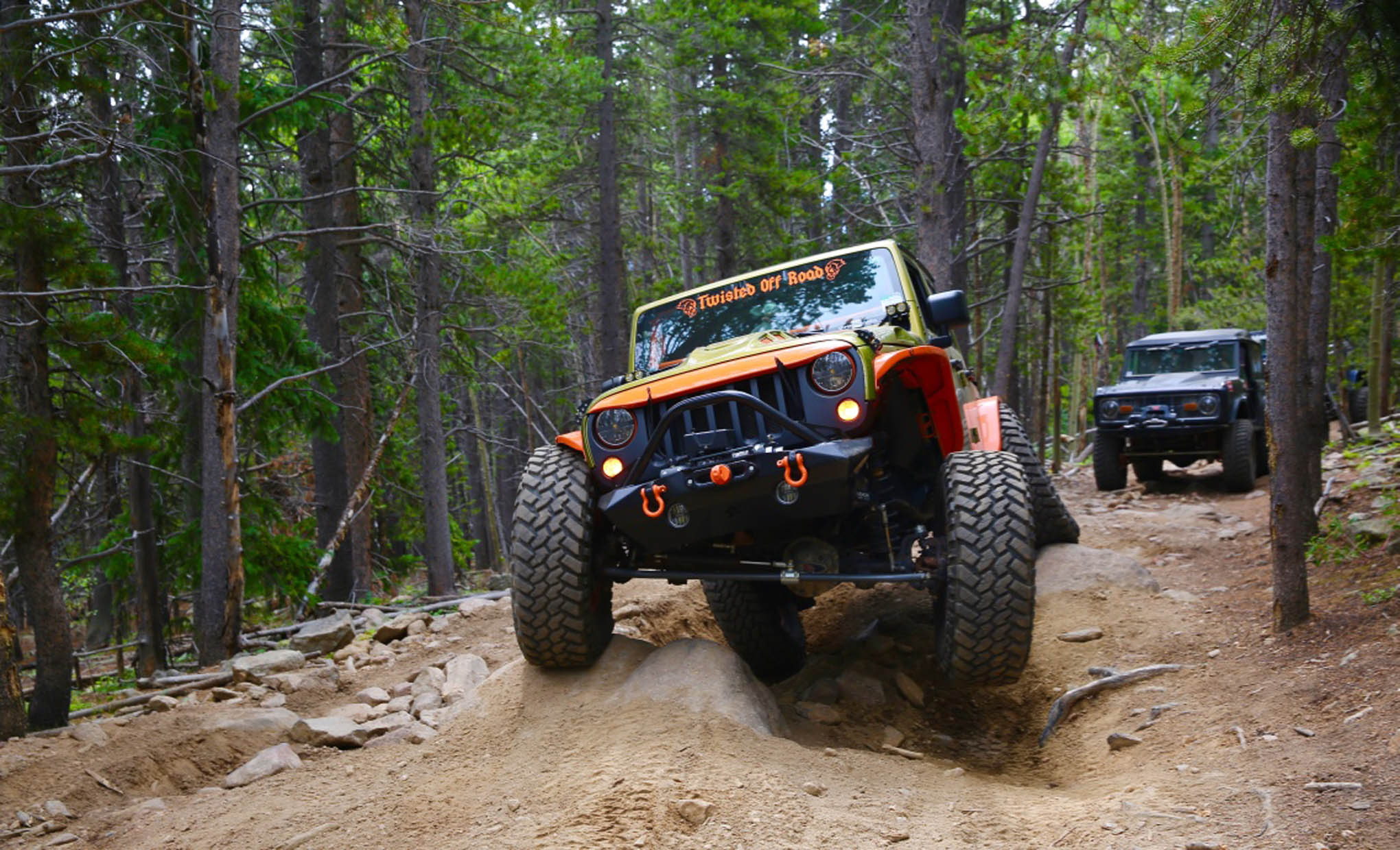Joey Brouchard of Twisted Off Road muscles his way up Red Elephant in his built Rubicon.