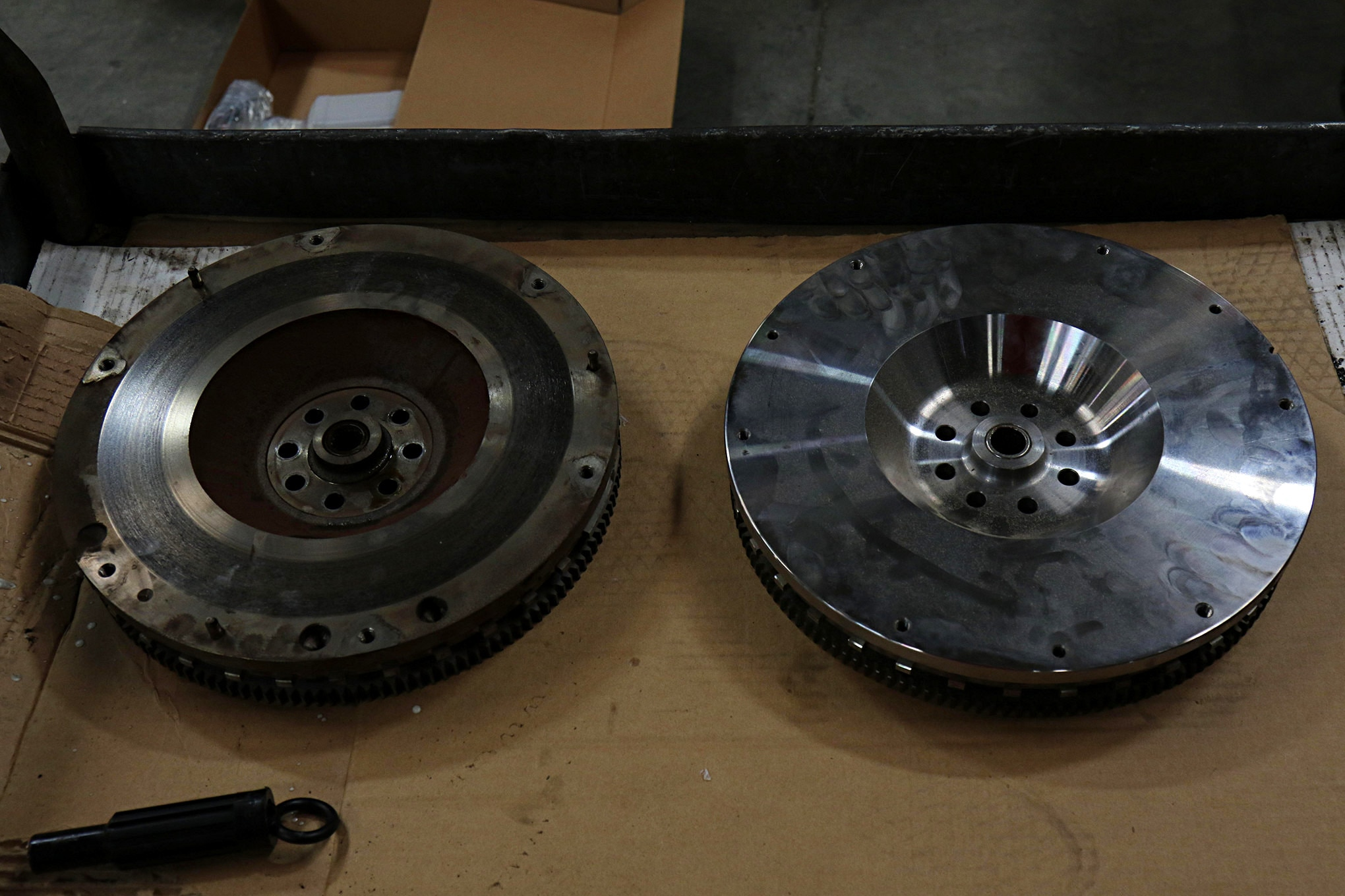 In a side-by-side comparison it's easy to see where Centerforce added 18 pounds of weight. The recessed center has more metal around it, fewer holes were drilled into the material, and overall the flywheel is thicker. The greatest advantage to the heavier flywheel is that it helps the engine to keep turning at lower rpm. That extra rotating mass has more inertia for low-speed crawling, and you can lug the engine down much more without stalling than you can with the factory setup.