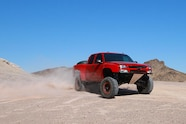 chevy red extrememotorsports mazzullaoffroad bfgoodrich method fox fiberwerx hannemann sliding front three quarter