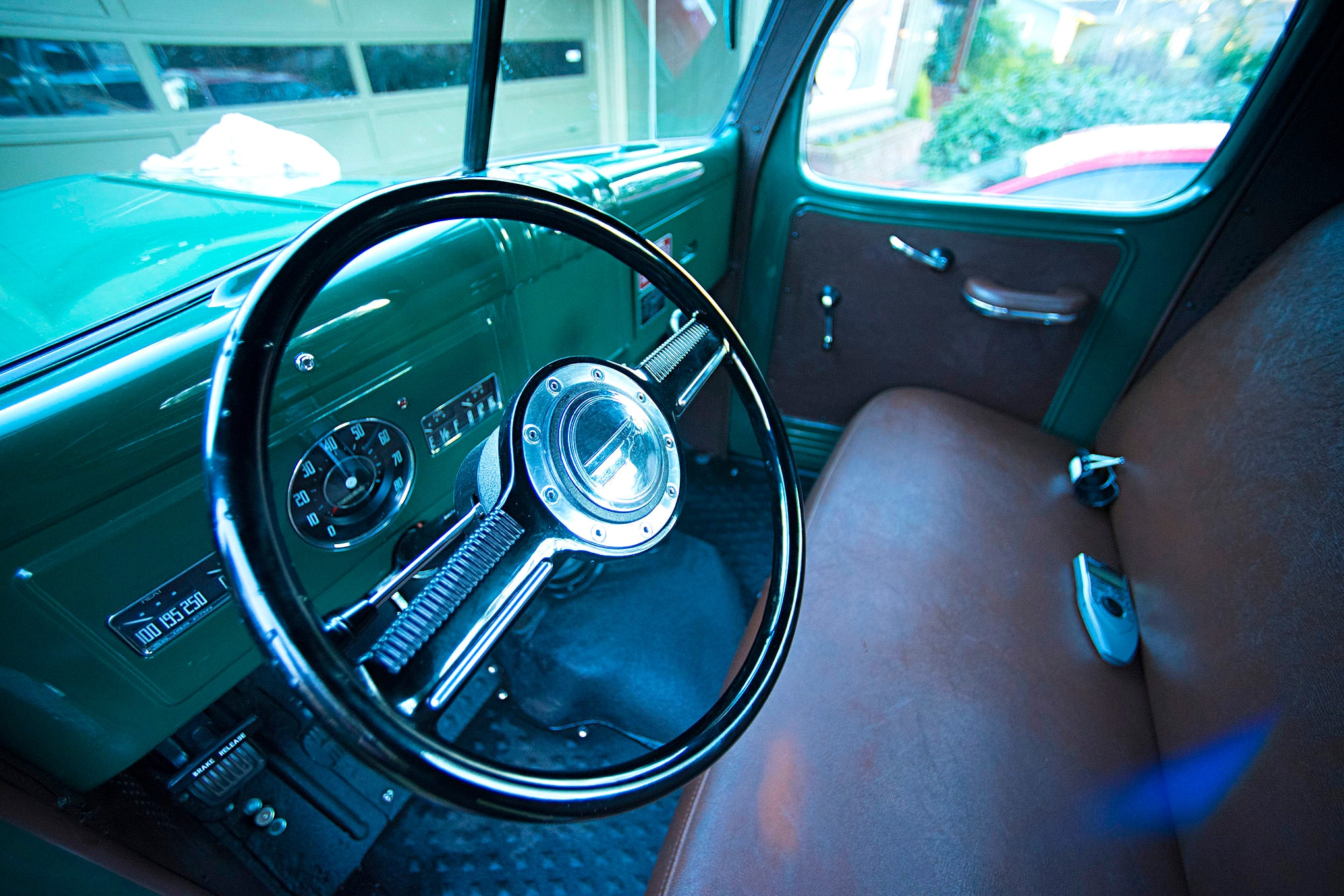 An ididit steering column and Lecarra Mark 10 steering wheel with a 1938 Dodge horn button fit right in with the interior motif. The stock Power Wagon gauges were restored and converted to electronic by United Speedometer Service in Riverside, California.