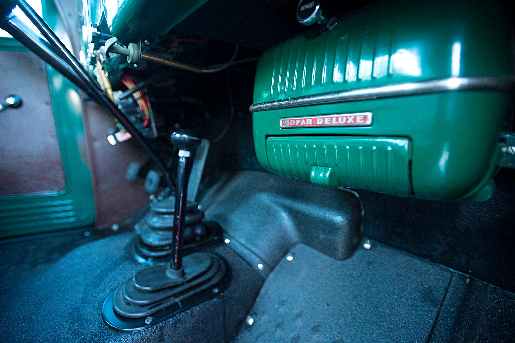 The interior is much less cluttered than it was in 1946, now with just a single transfer case lever and shifter mounted on the floor. A stock Power Wagon heater works great in the little cab even in the middle of winter. The floor is coated with Line-X for easy wash-and-clean.