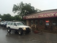 jeep in front of cherokee trading store.JPG