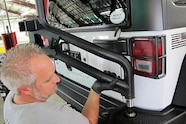 021 jeep jk aev american expedition vehicles rear tire carrier water tank system.JPG