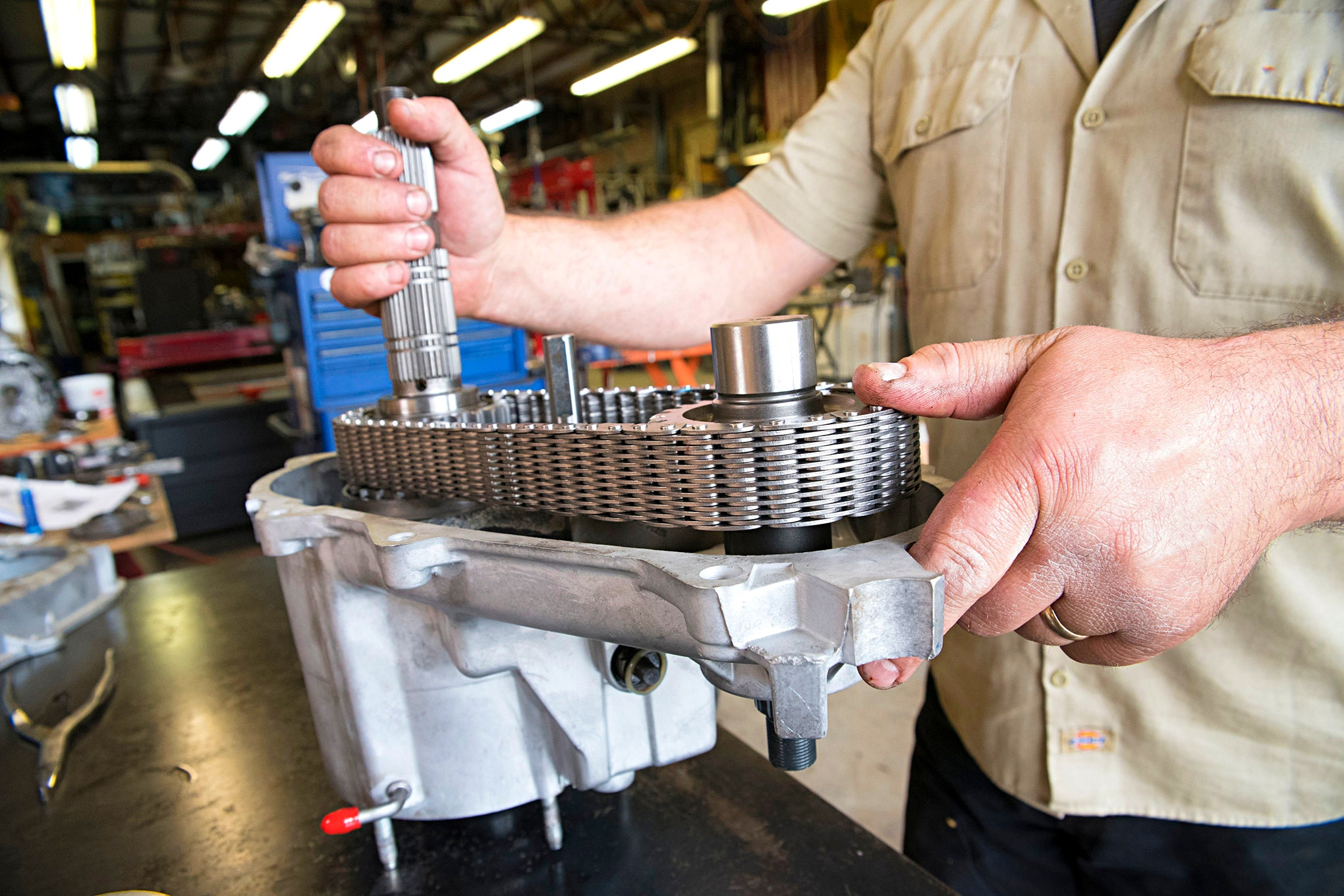 Replace the gears on the new shafts, install the new wide-chain, and then drop both shaft assemblies back into the case as one unit. The heavy duty chain is a 1/2-inch wider than the OEM version.