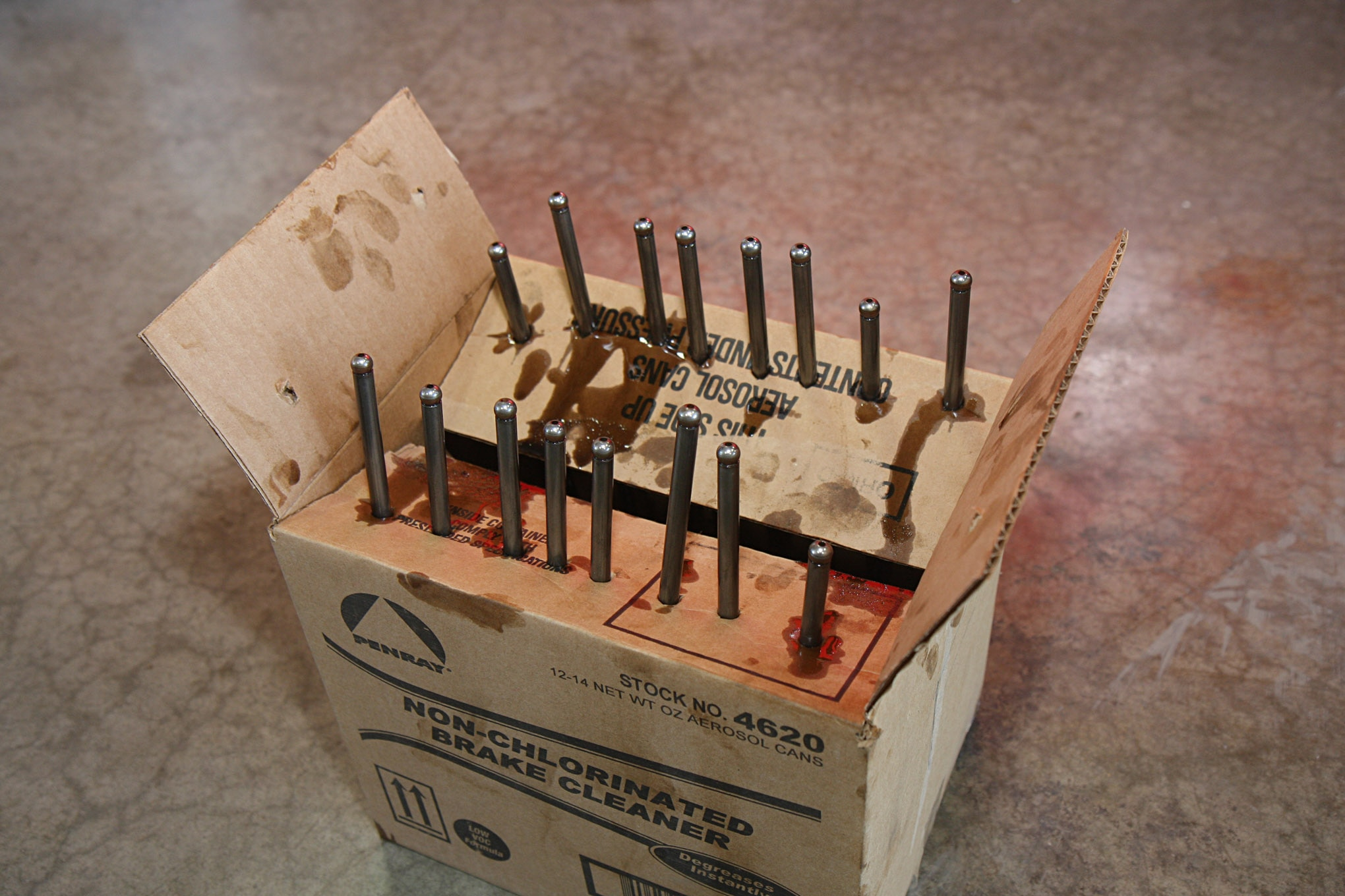 To keep everything in the valvetrain in perfect sync, all 16 pushrods are arranged (in the upside down cardboard box shown) in the same position they were on the engine. The same was done for the rocker arms and valve bridges. You never want to let an unrelated engine repair disrupt valvetrain components that were operating in perfect harmony.