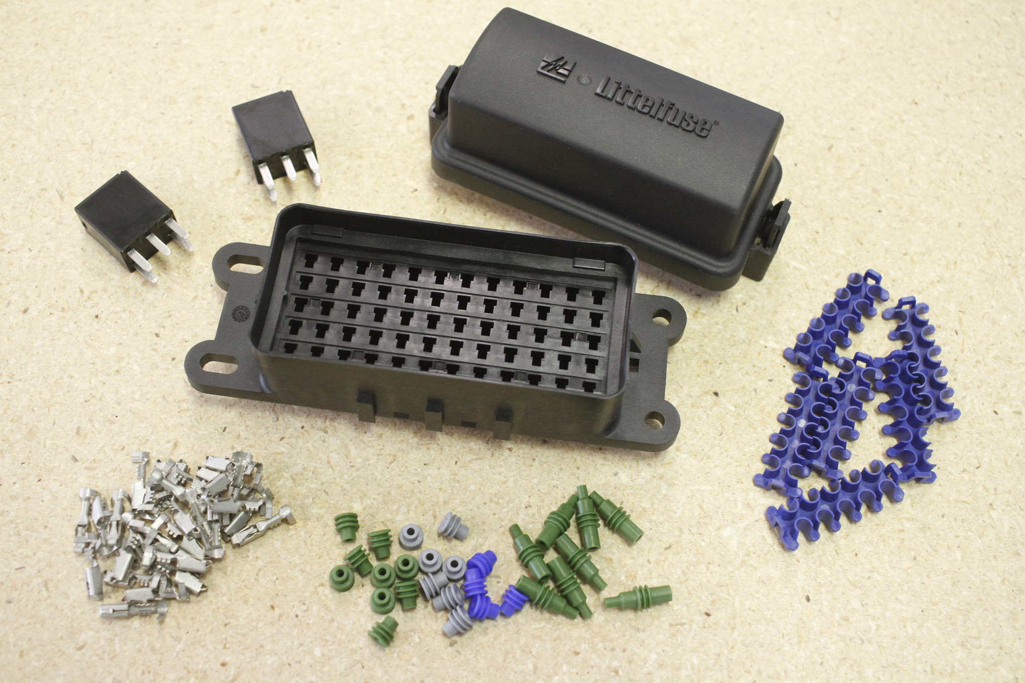 a lot of harness builders use a simple, open four fuse block for the Panel Mount Fuse Holder
