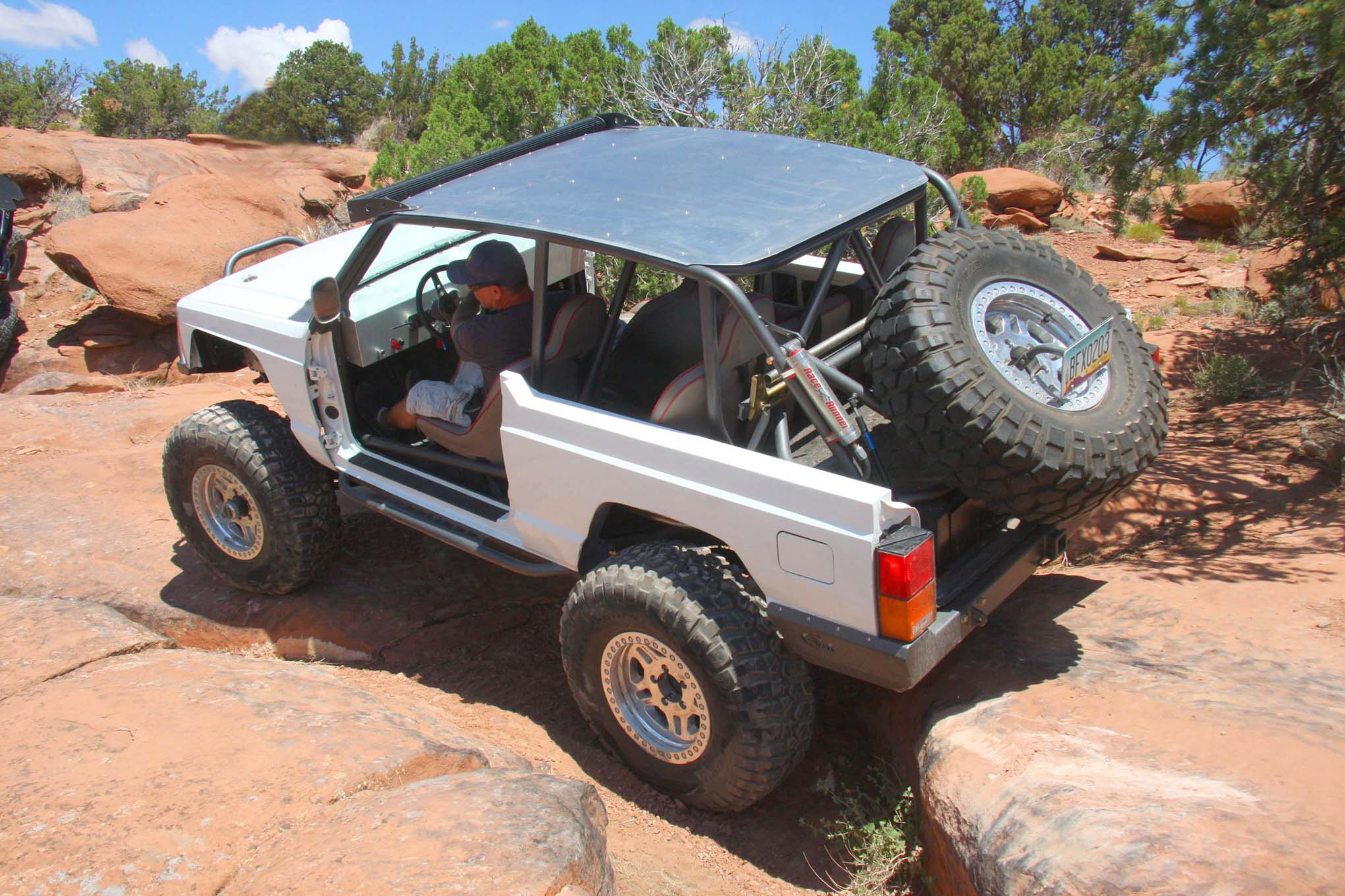 This Altered XJ Off-Roads Topless