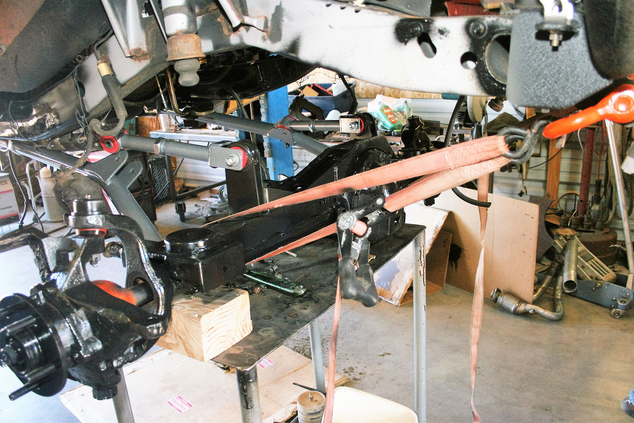 Just as we did with the front axle, adjustable straps were used to hold and position the rear axle in place underneath the Jeep. This allowed us to fine-tune the position of the axlehousing while bolting all of the Y-link components into place.