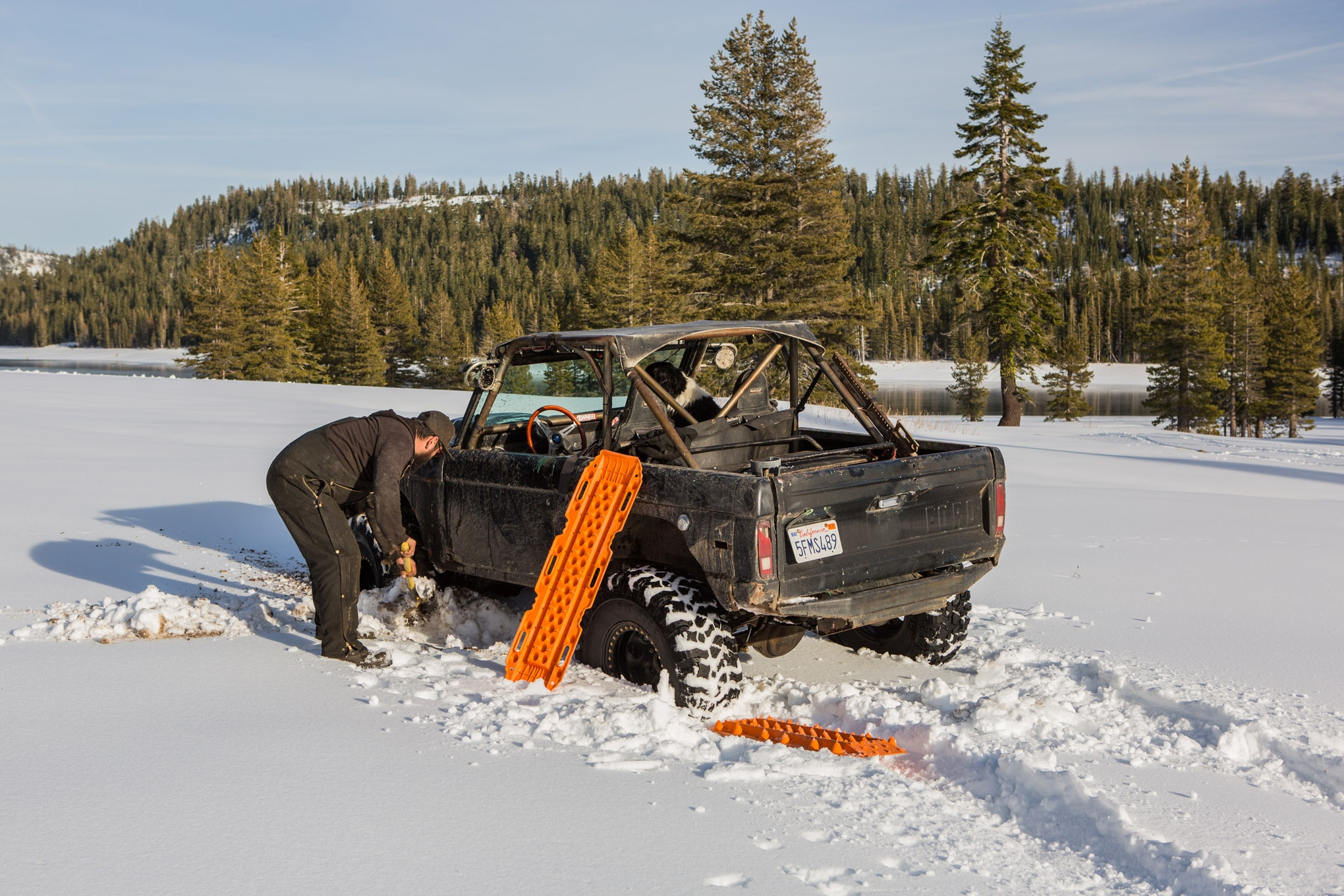 A Maxtrax is a useful tool that can help you get back on top of the snow if you break through the crust. Some work with a shovel beforehand will make the process easier, and we recommend carrying four Maxtraxes so you'll have one for each corner of the vehicle.