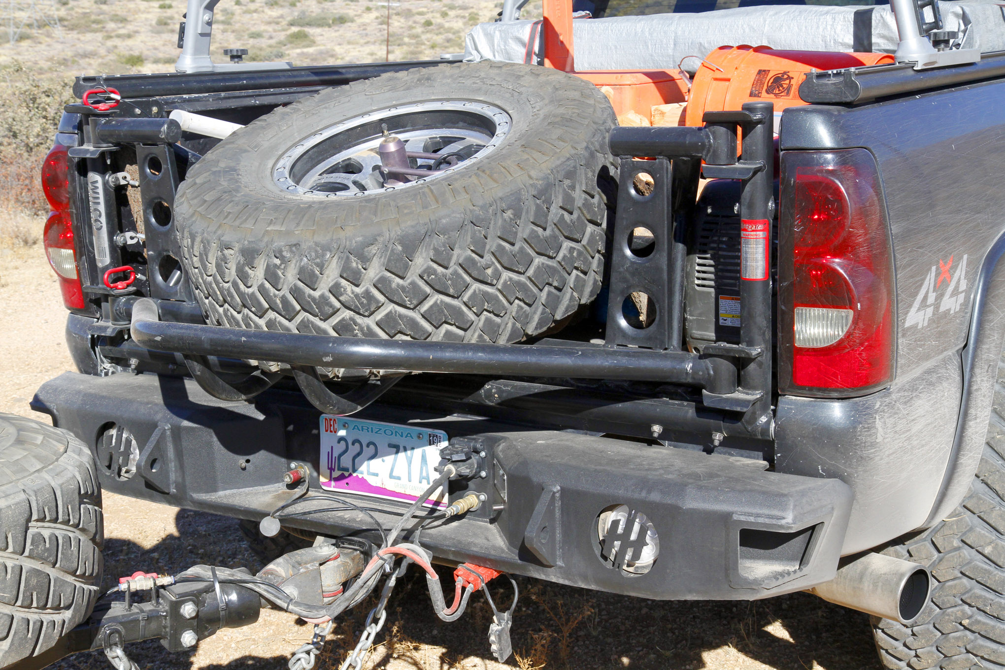 At the rear of the truck, you'll find another Hammerhead bumper and a Wilco Offroad Tiregate supporting a fullsize spare tire that will fit the truck or trailer.