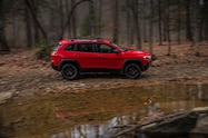 2019 Cherokee trailhawk moving profile rocks water