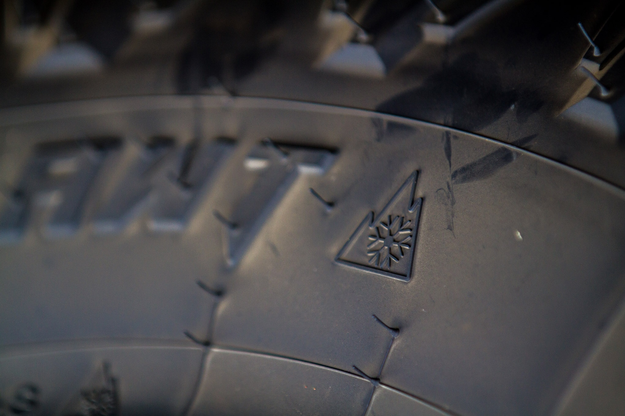 """""""M+S"""" denotes a mud and snow tire, which may get you past the Department of Transportation road workers on a snowy road, but the rating really doesn't mean a whole lot. The Three Peak Mountain Snowflake has more stringent requirements. In order to meet this standard, the tire must attain a traction index equal to, or greater than, 110 (compared to a reference tire, which is rated 100) during traction tests specified by the ASTM on packed snow."""