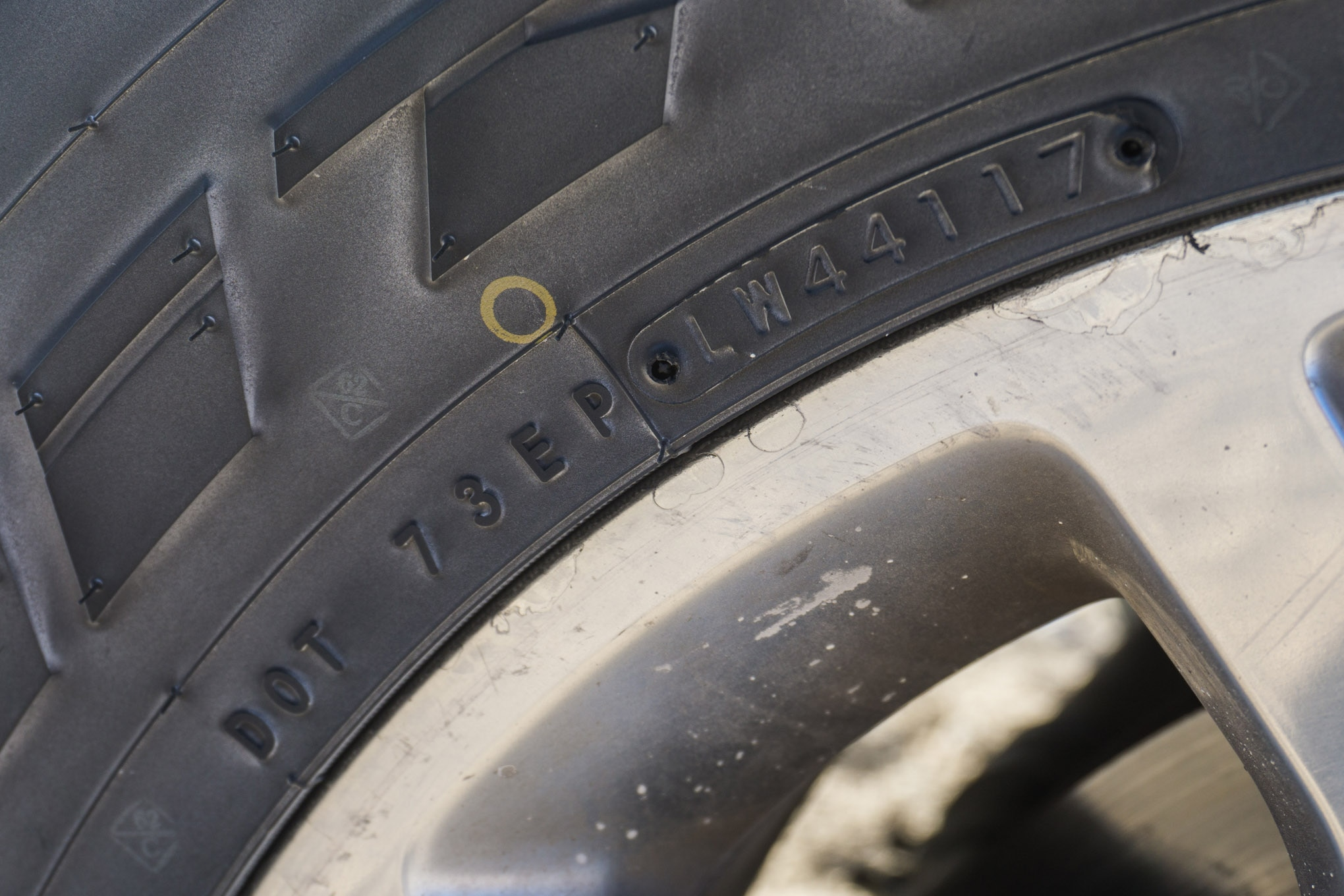 """Shopping for used tires? You will want to look at the last four numbers of the DOT code to determine just how old the tires are. Even if they have full tread, an older tire, particularly one that has spent a lot of time in direct sunlight, can be compromised. """"4117"""" is the month and year that this tire was manufactured. So this tire was made in the 41st week of 2017."""