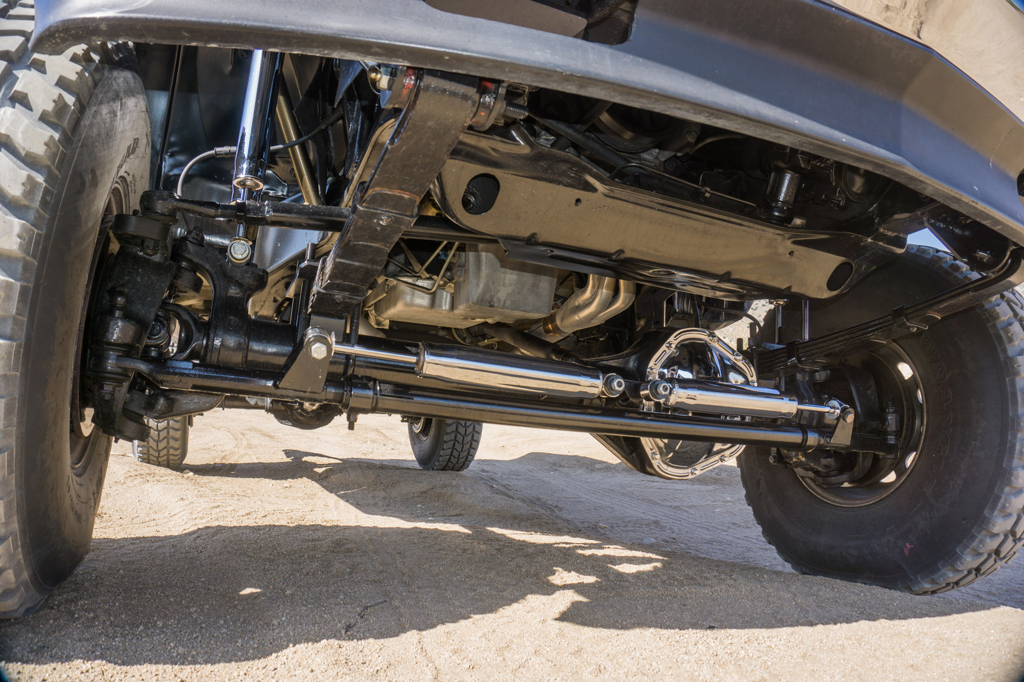 "This might be the first time you've seen chrome shocks in PETERSEN'S 4-WHEEL & OFF-ROAD since David Freiburger took over as editor in 1994, but we think enough time has passed to point out the study in contrasts on this GMC. The Offroad Design solid-axle swap kit and a 1-ton front axle suggest it could do some legit wheeling. At the same time, the dual chrome shocks and chrome diff cover scream ""show truck!"""
