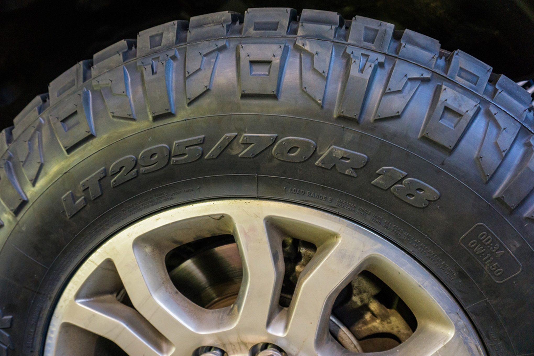 """Metric sizing is more common these days than floatation sizing and, like the rest of the metric system, can seem a bit foreign. In this example, """"295"""" is the section width, in millimeters. The larger the number, the wider the tire. """"70"""" is what is called the aspect ratio, which means that the sidewall is 70 percent of the section width (70 percent of 295 mm is the sidewall height). A higher aspect ratio results in a taller sidewall, but also a wider section width with the same aspect ratio also results in a physically taller sidewall. After all that metric math, """"18"""" is the rim diameter in inches."""
