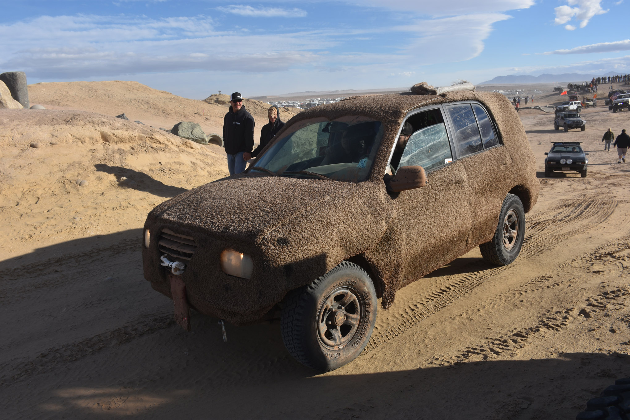 Is that the most annoying sound in the world? It's not every day you see Lloyd and Harry cruising the sheep dog at your favorite off-road event. It's good to see these guys are still friends after all those adventures and many years gone by. In all seriousness, we think that's a late-model Geo Tracker under that brown carpet. Whatever it is, seeing it wheel was almost as much fun as the guys driving it were having!