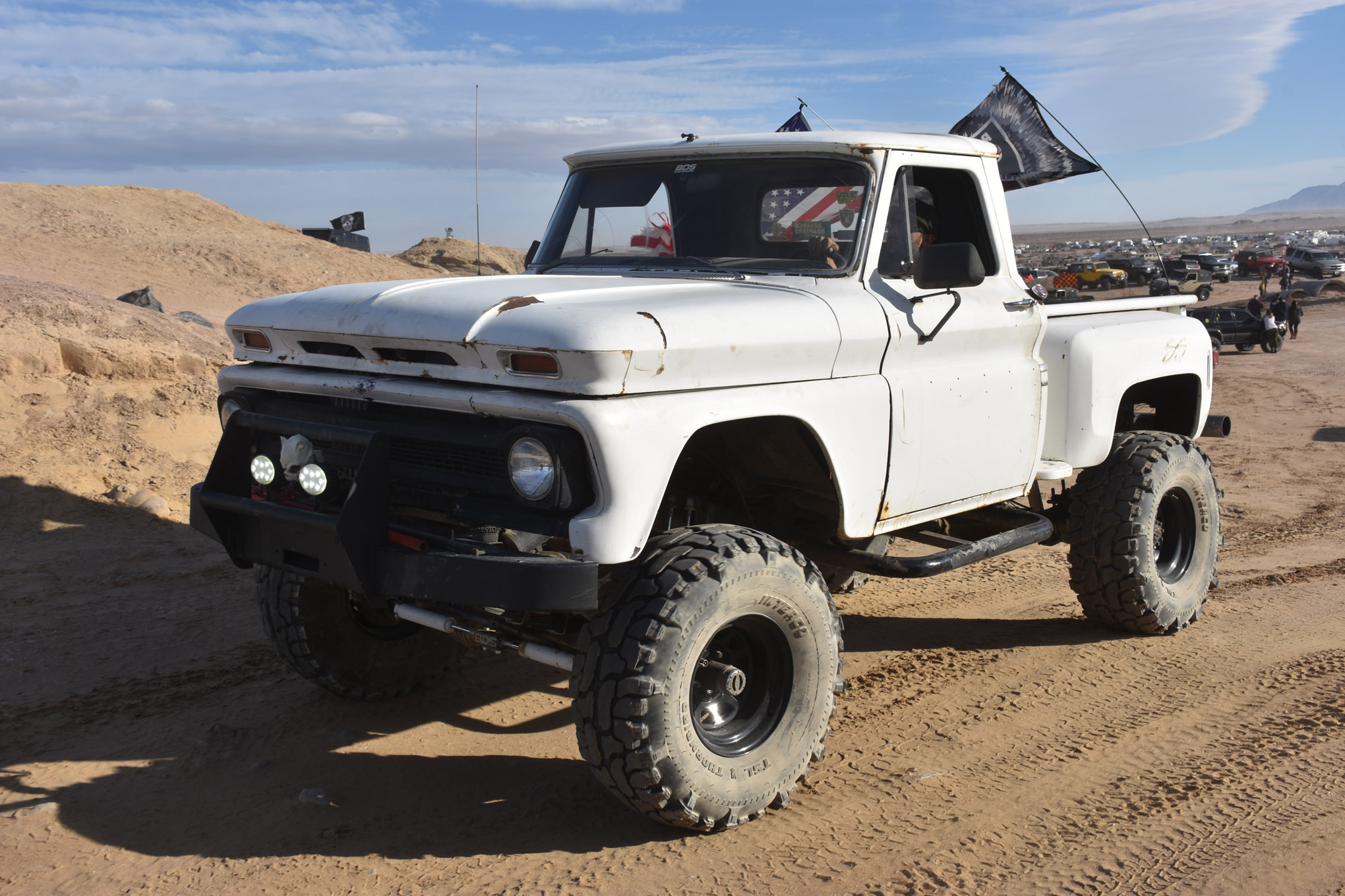 Vintage iron in use is always fun to see. How about this rowdy-looking 1960s Chevy C-10 truck? Where's a mud hole when you need one?