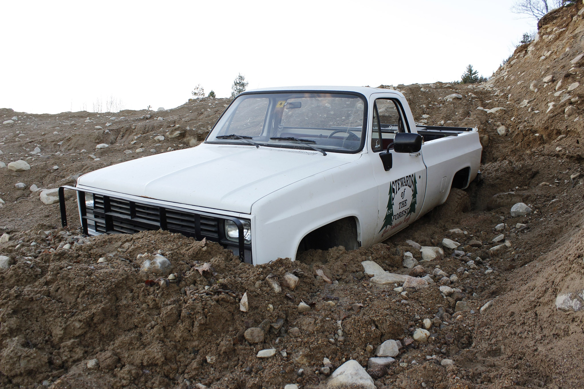 whoops square body chevy k30 stuck in mud lead